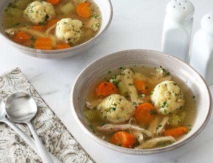 Bowls of matzo ball chicken soup.