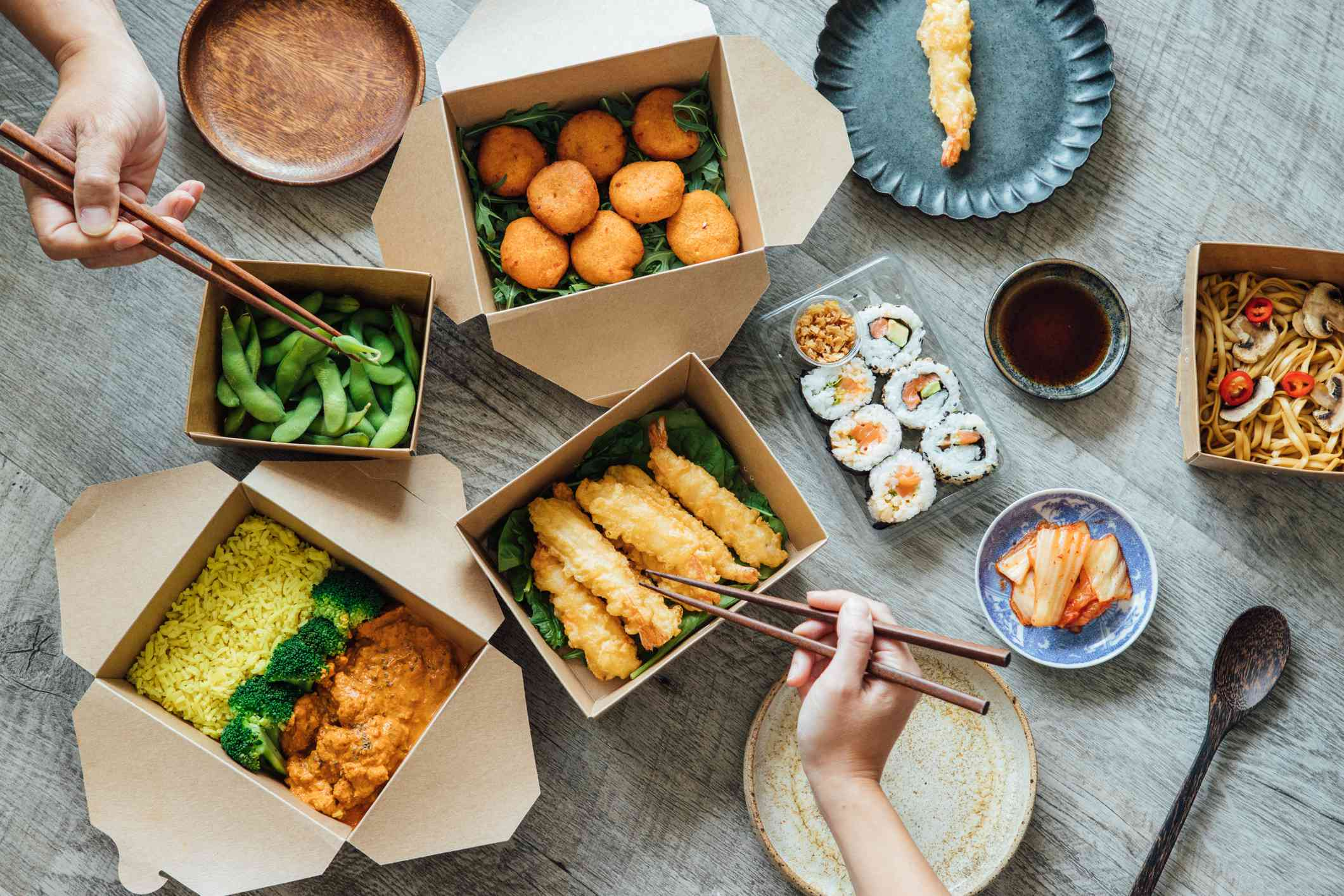 Sharing Assorted Takeaway Meal At Home