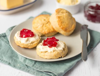 British scones with cream and jam on a plate