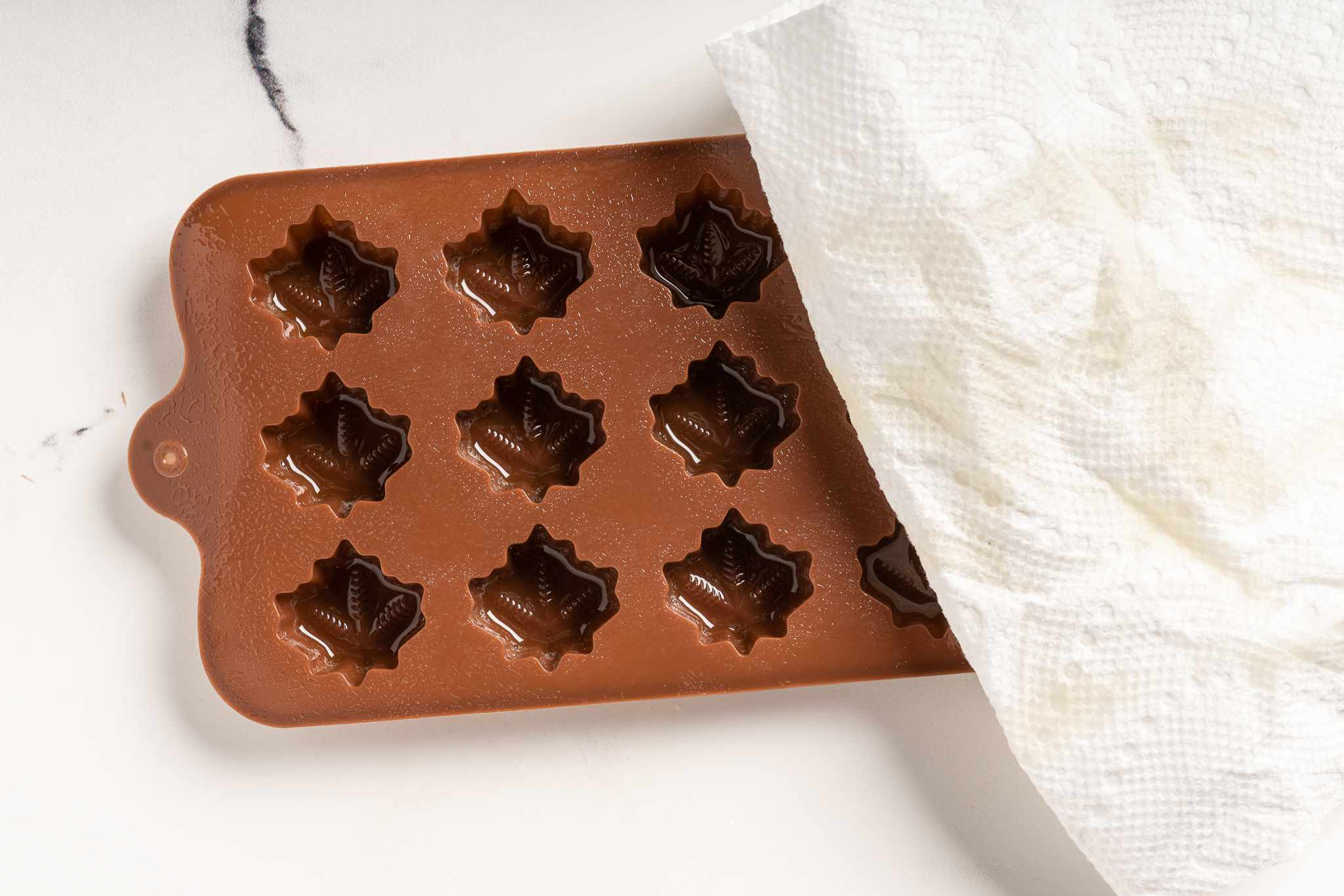 wipe off the extra cooking spray off the candy molds
