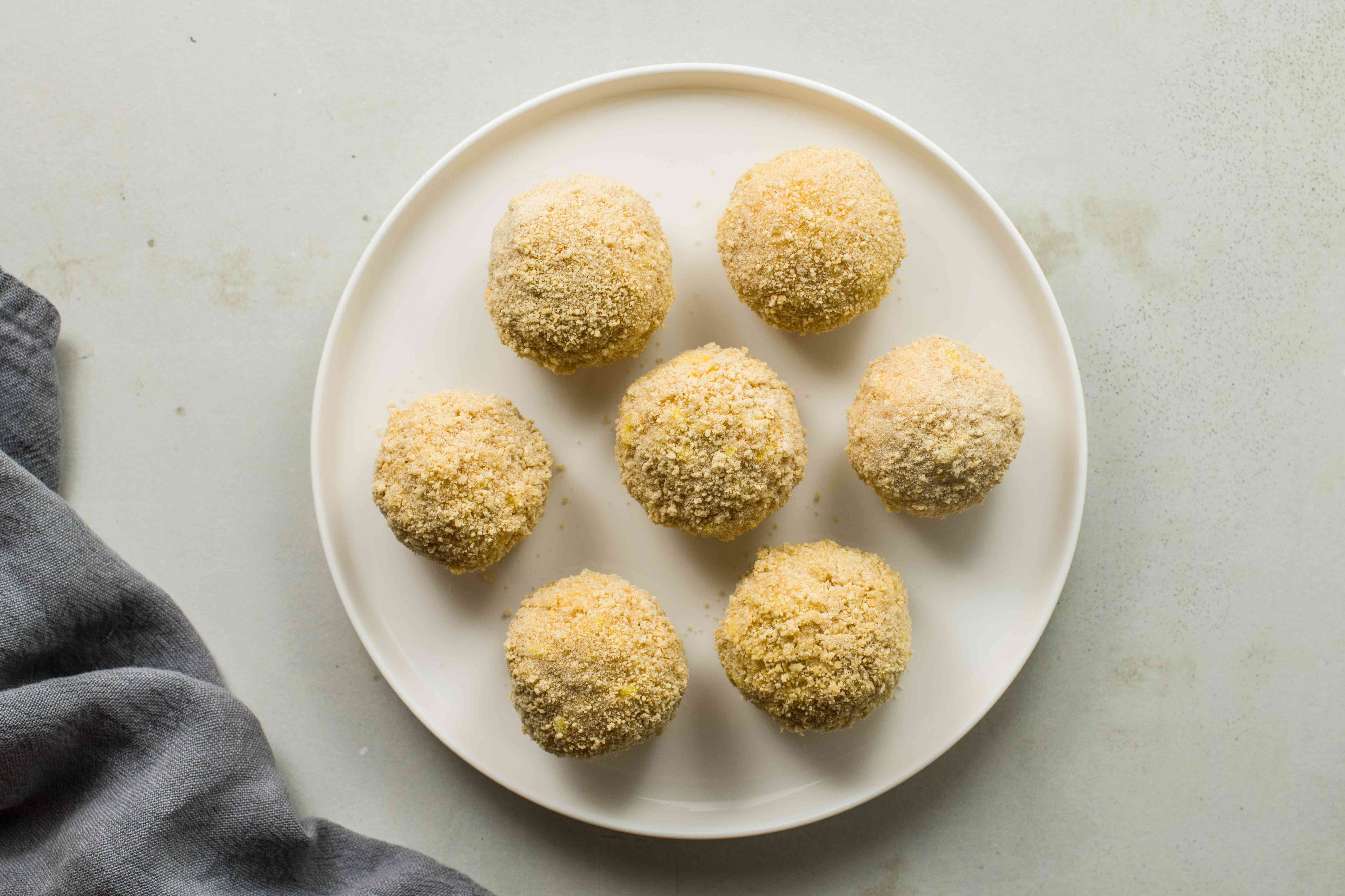 Rice balls on plate rolled in breadcrumbs