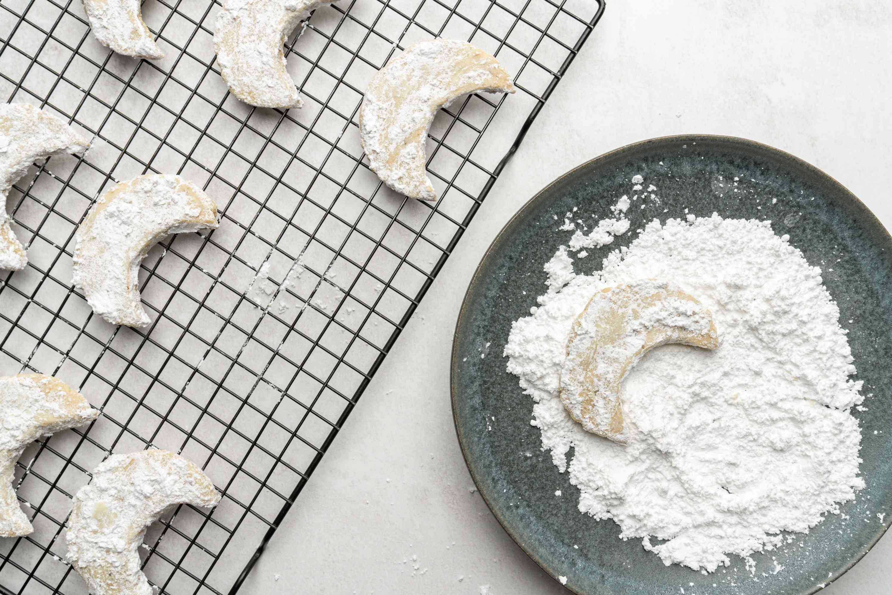 Walnut Crescent Cookies on a cooling rack