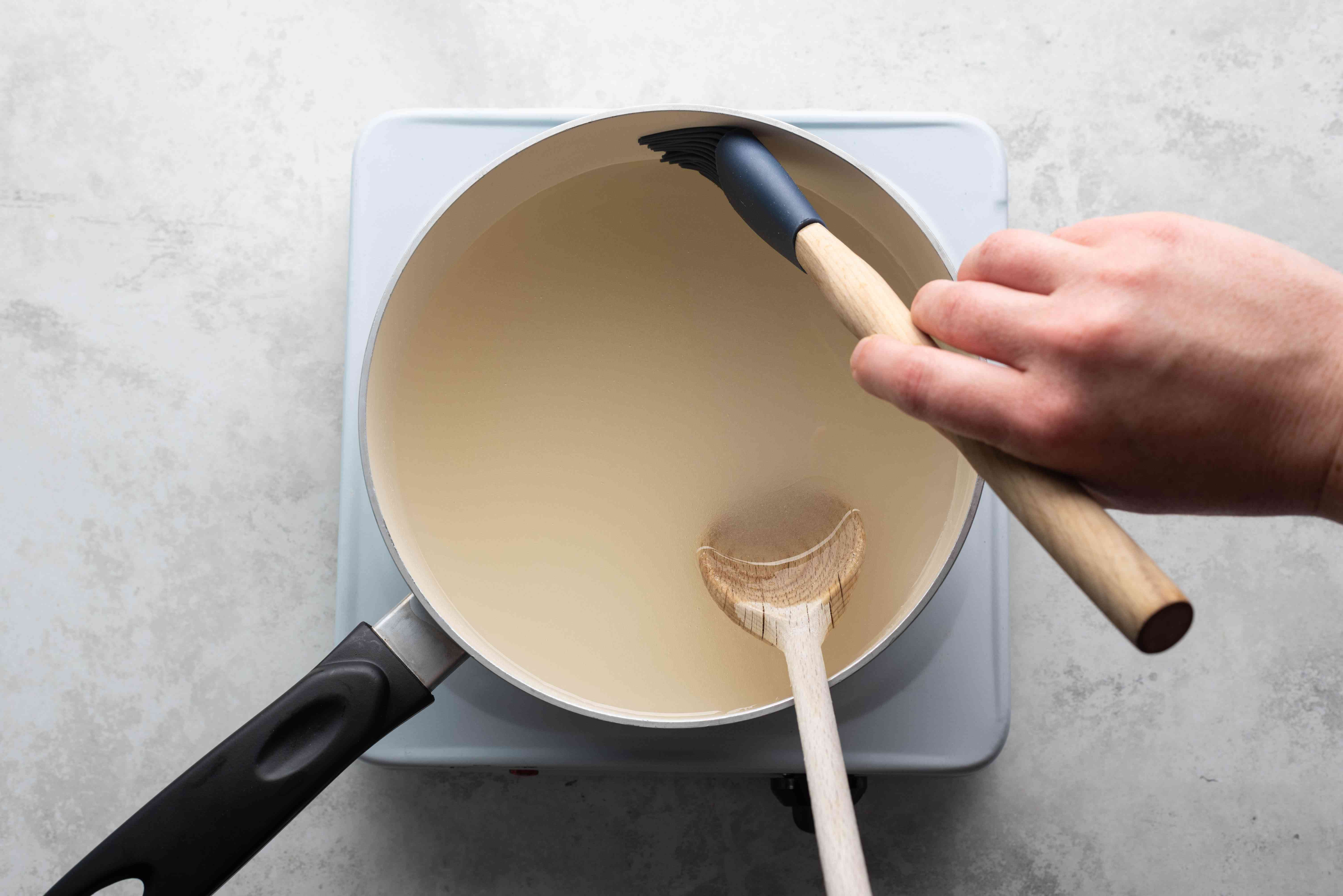 brush down the sides of the pan with a wet pastry brush to remove any stray sugar crystals
