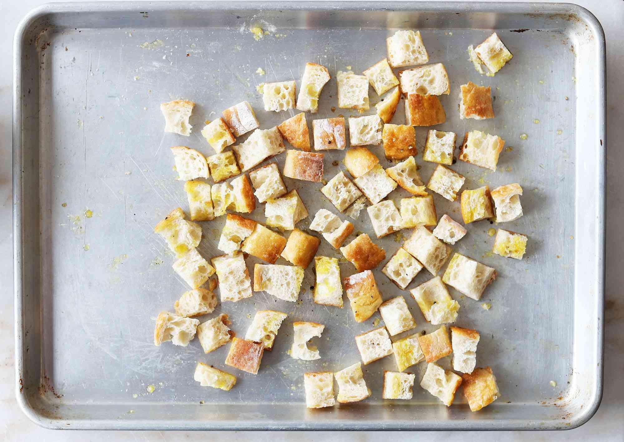 garlic croutons on a baking sheet