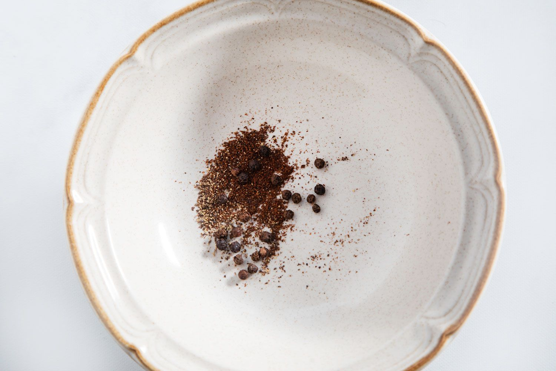 peppercorns and clove in a bowl