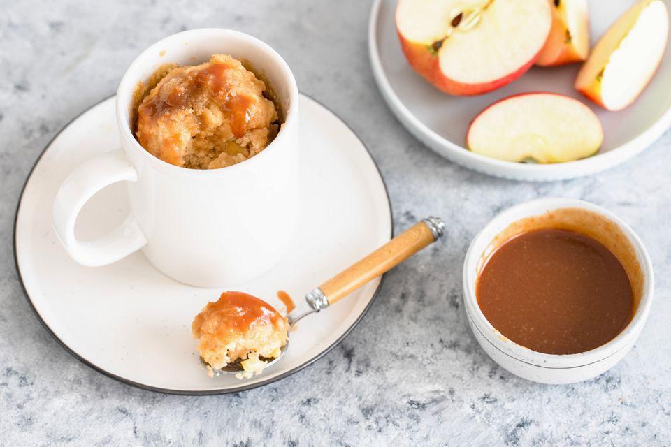 mug cake with apples and caramel sauce