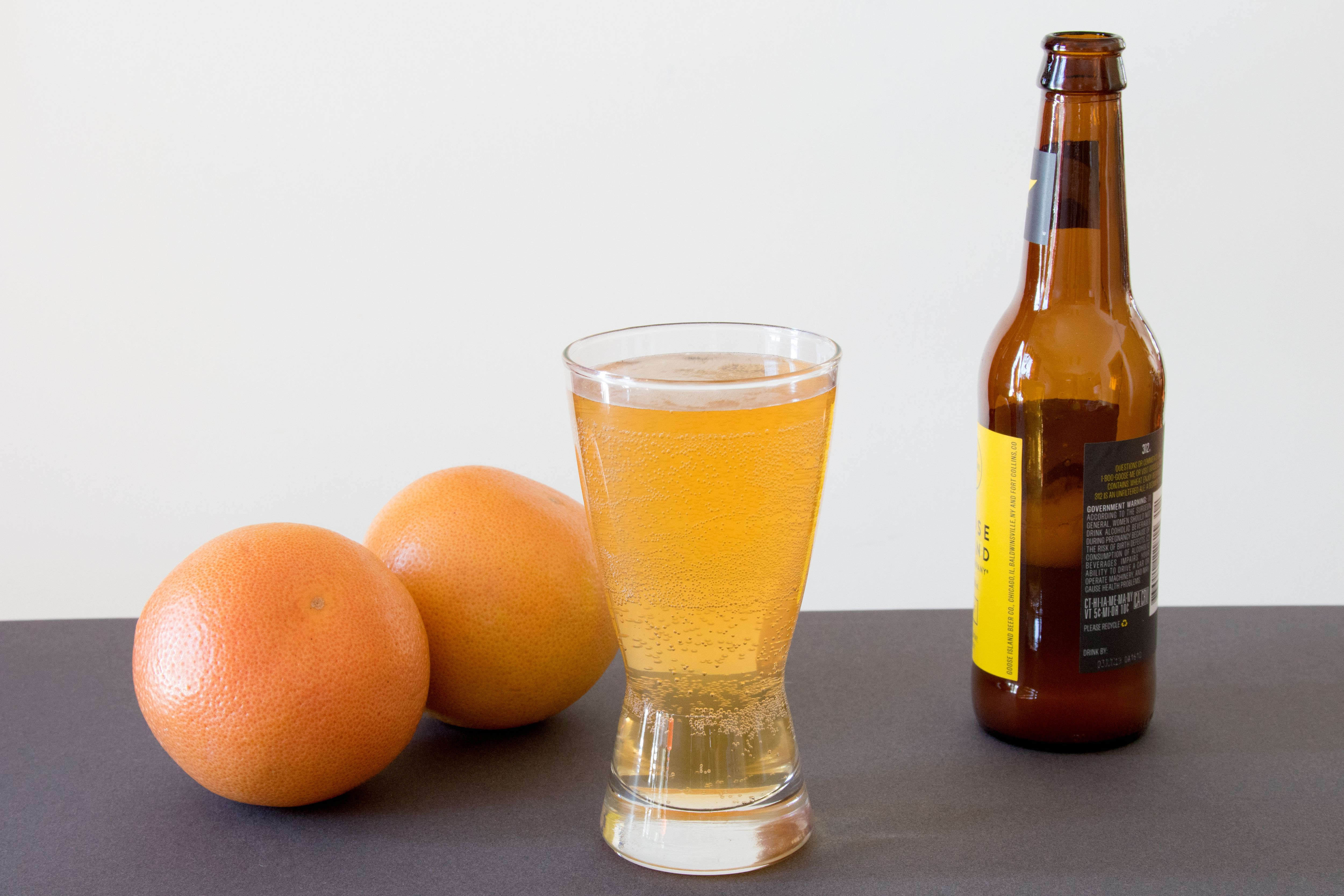 Pouring Wheat Beer for a Grapefruit Shandy