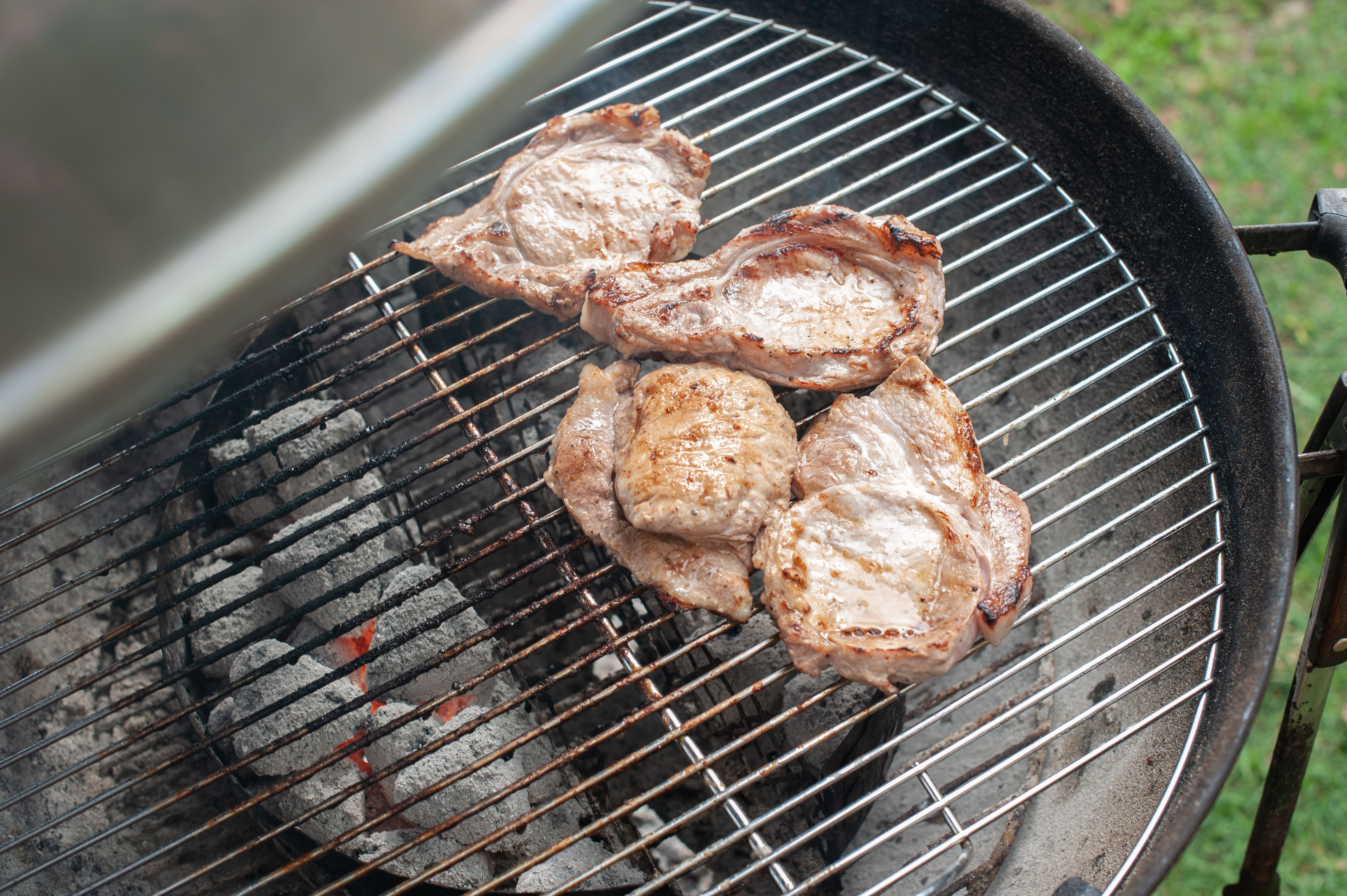 Grilling pork chops marinated in ranch dressing
