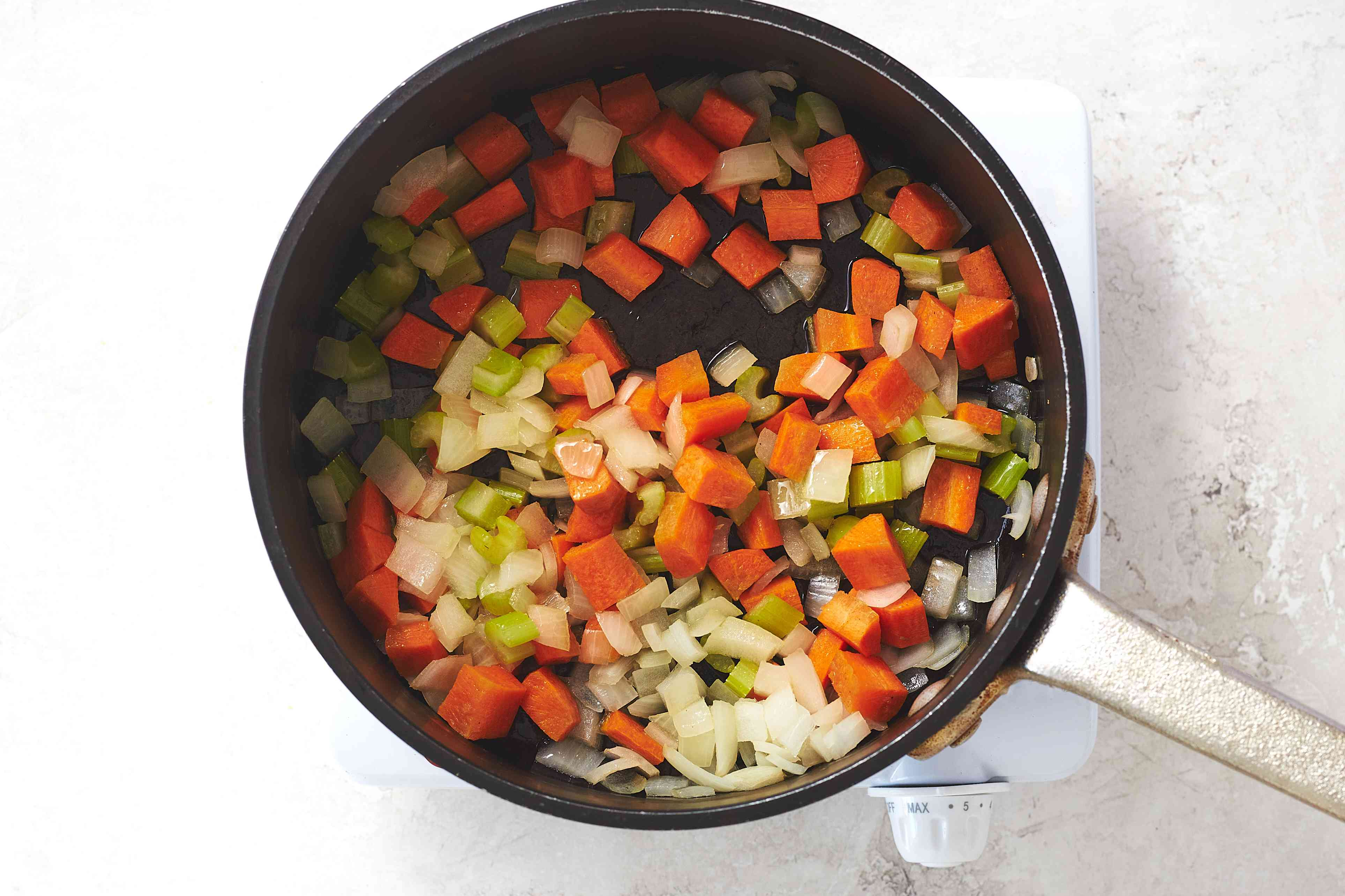 Sauté the onion, carrot, and celery in olive oil