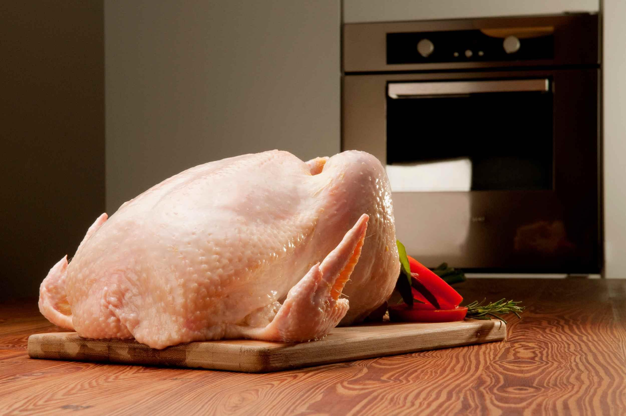 Raw turkey on a cutting board