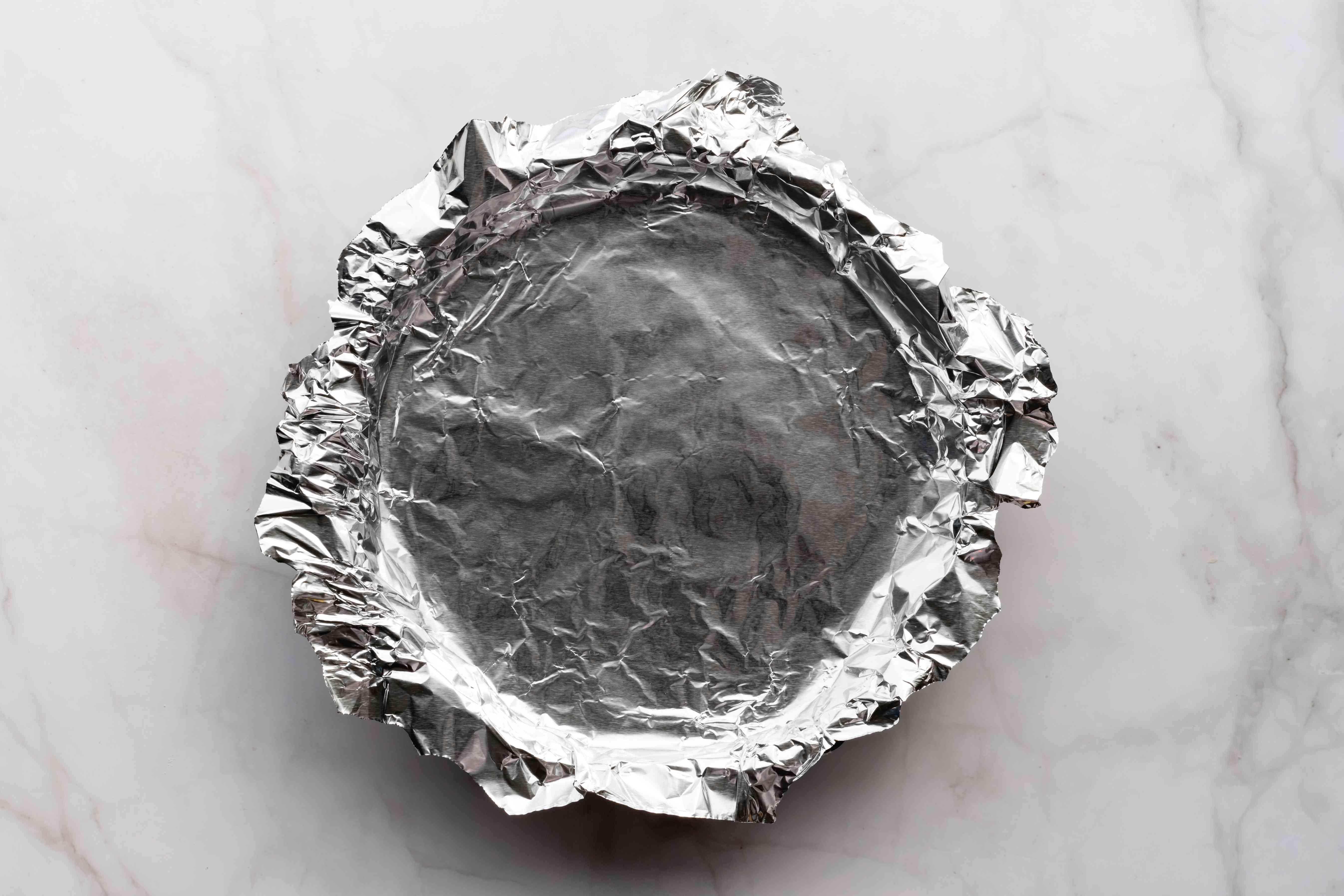 aluminum foil over on top of tart dough in a tart pan