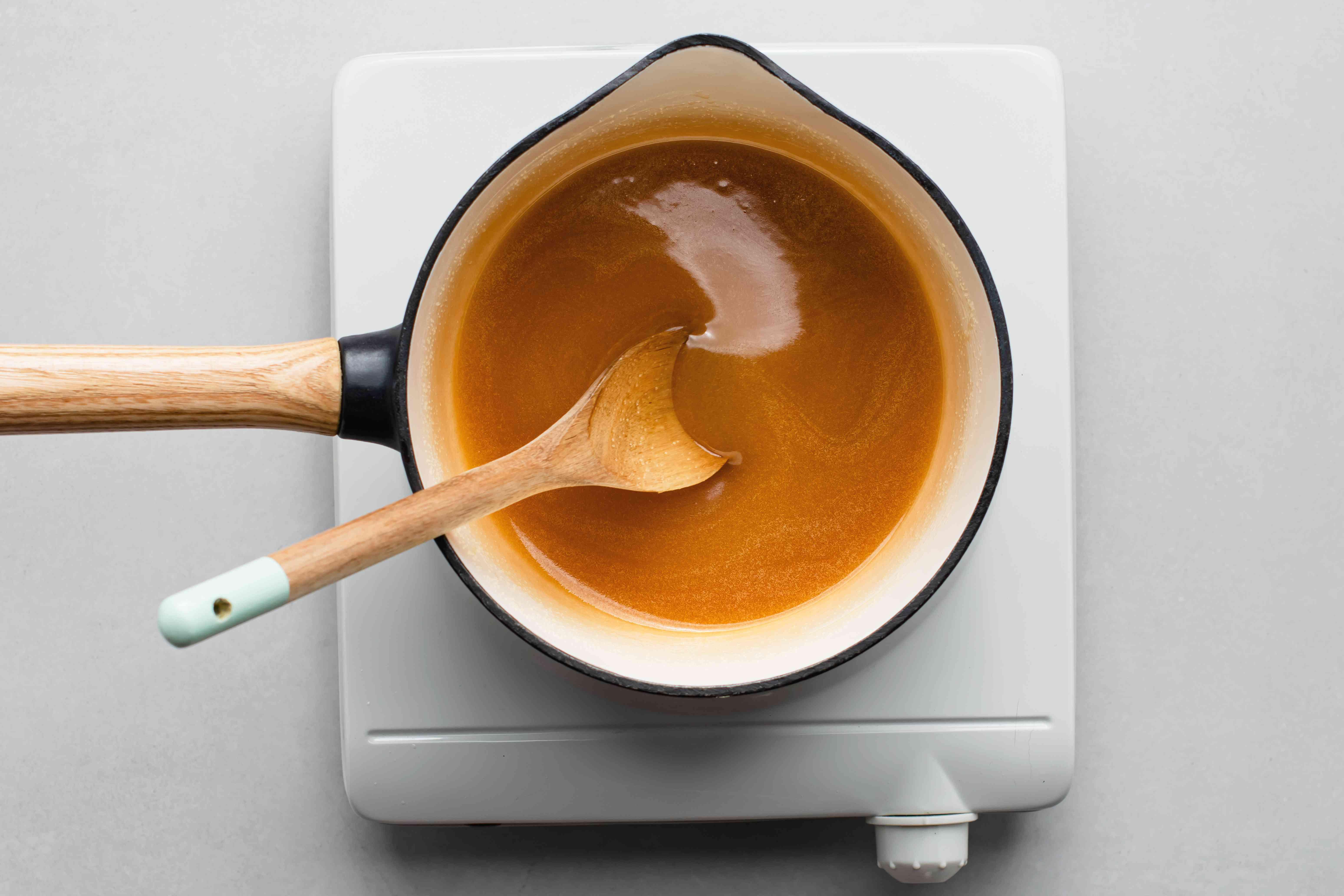 Melting butter, sugar and vanilla in a saucepan
