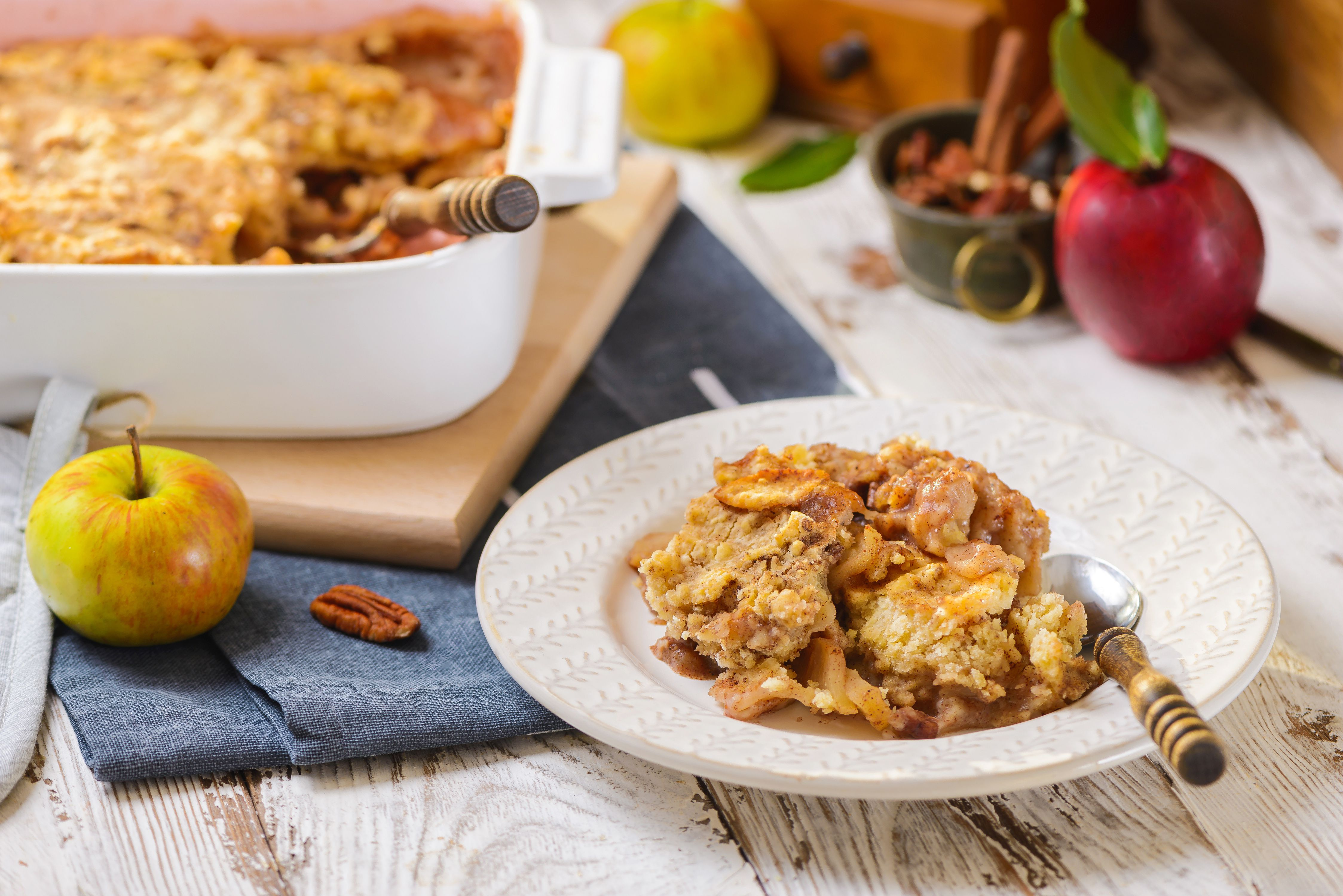 Apple dump cake on a plate with a spoon