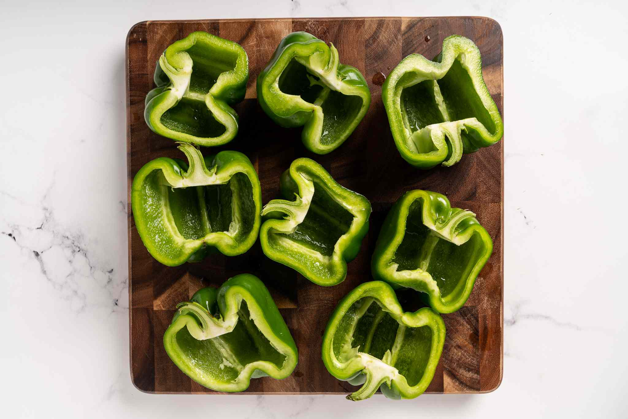 Cut four of the peppers in half lengthwise