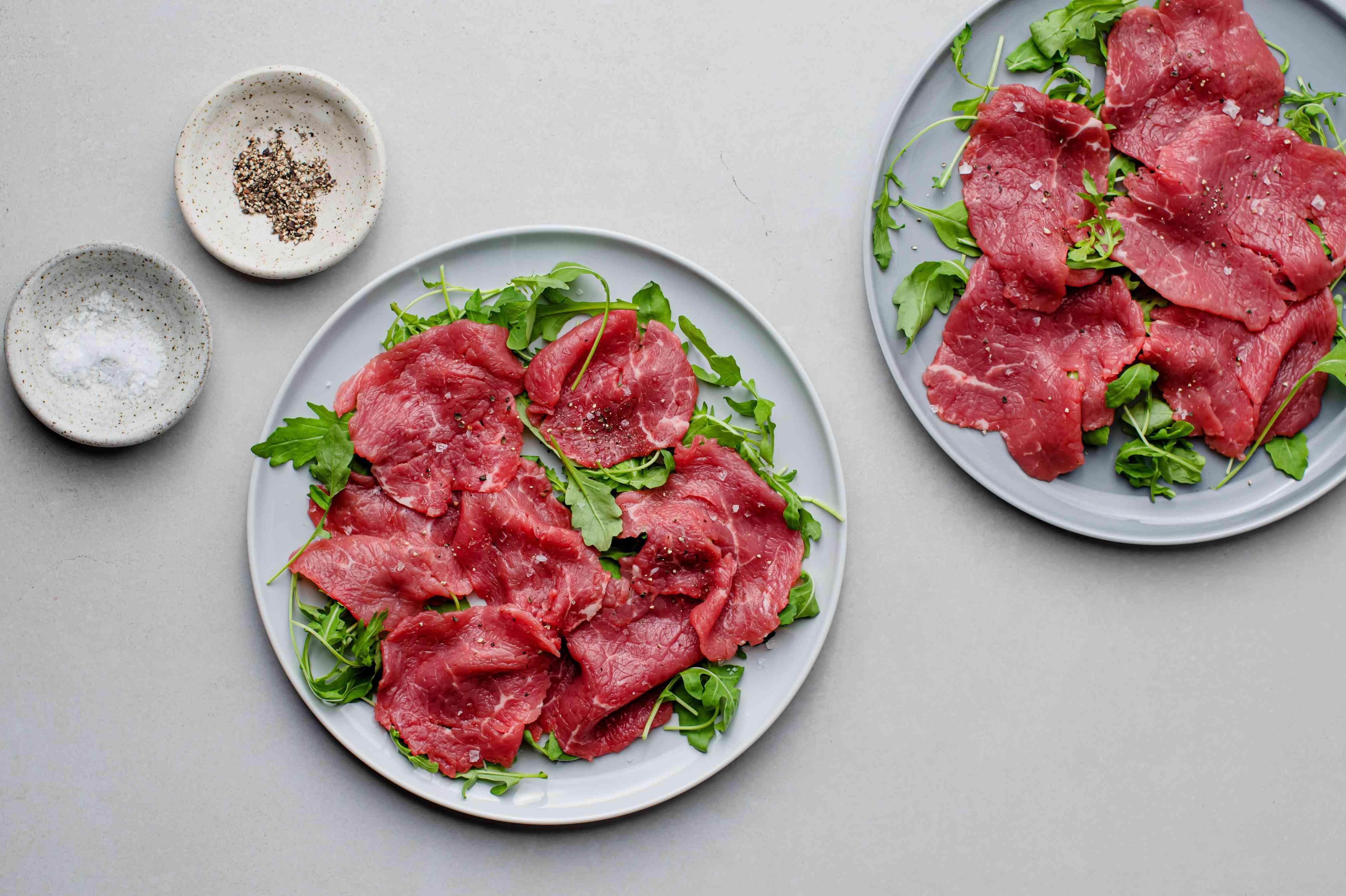 carpaccio meat on a pate of arugula