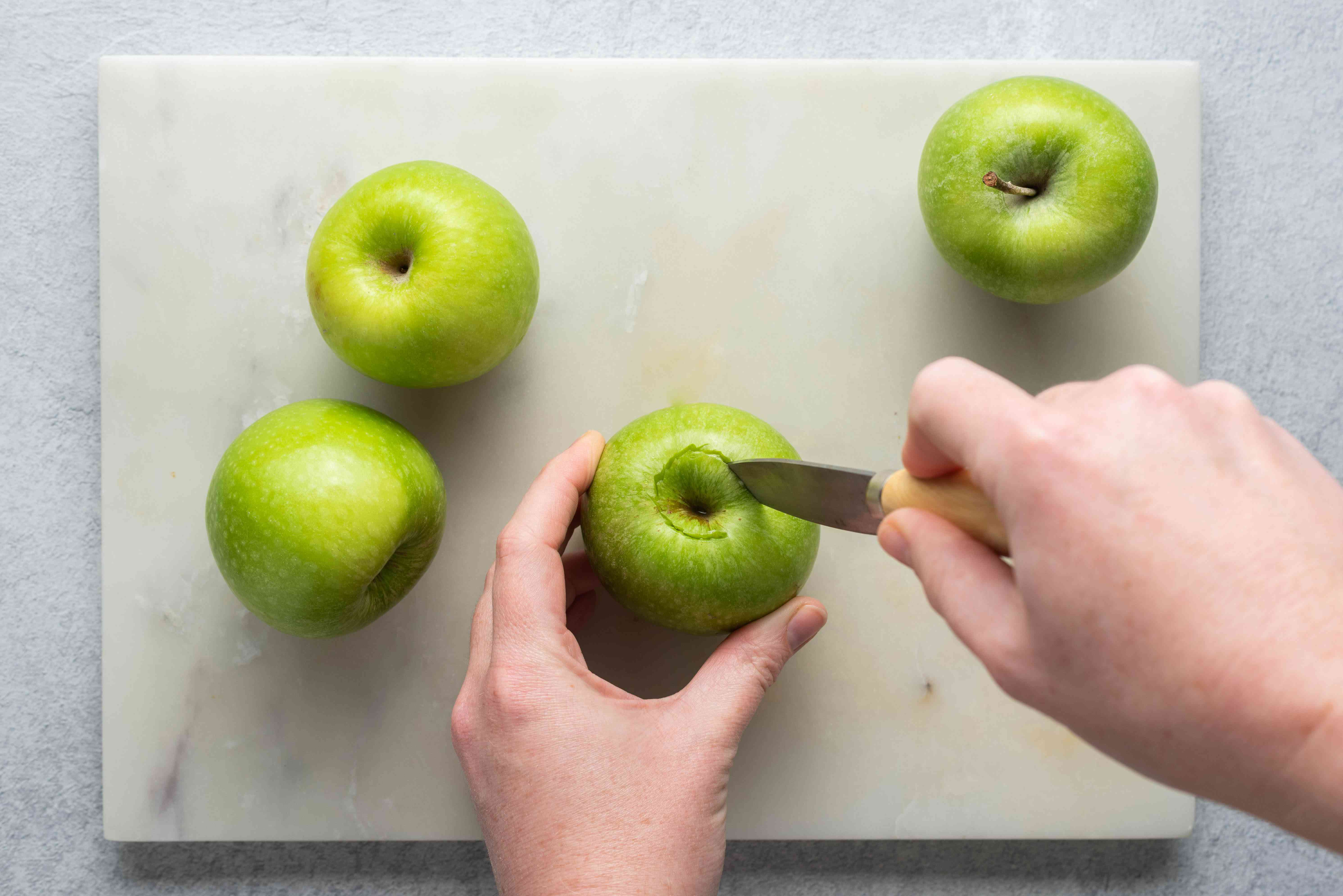 Cut around the core of the apple starting from the top to remove the inner core and seeds