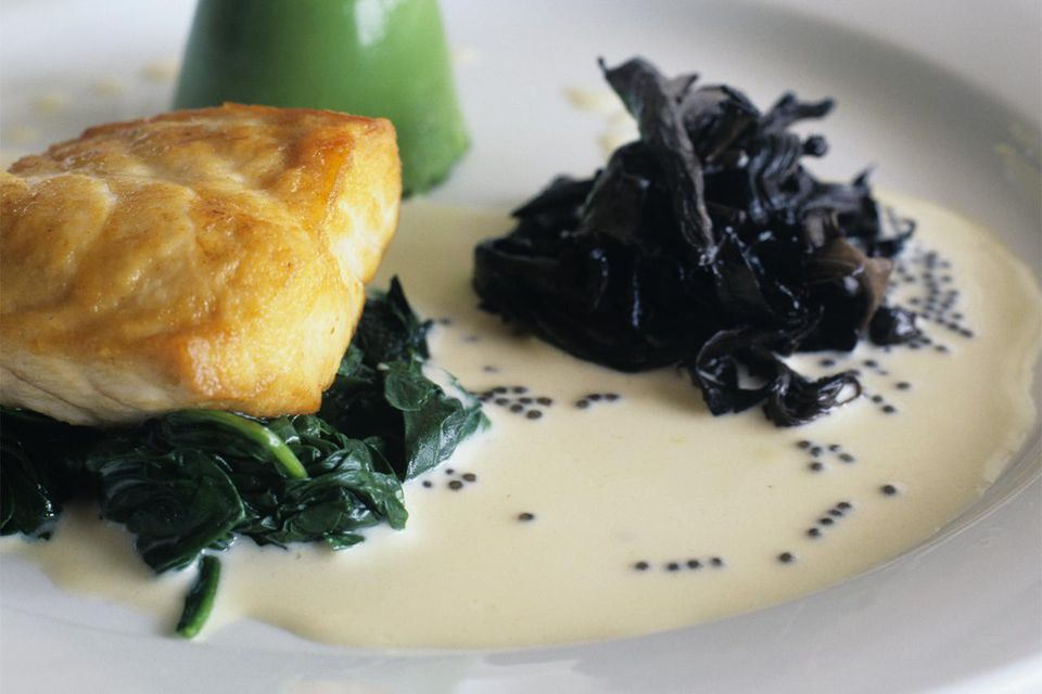 Sturgeon with spinach flan, black trumpet mushrooms and white wine sauce