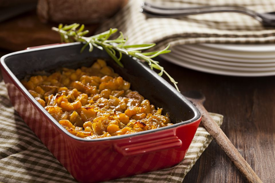 Baked bean casserole in pan on table
