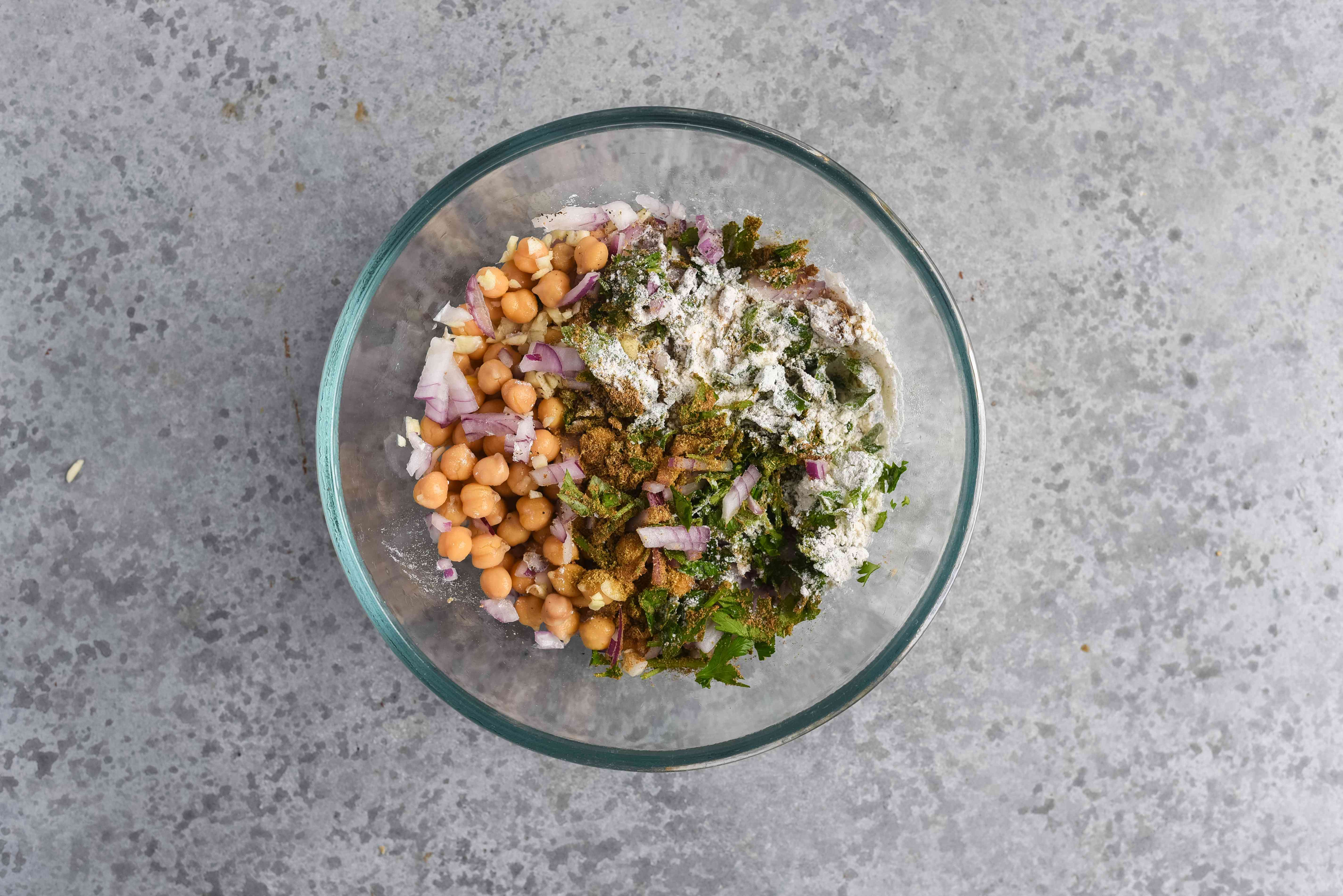 Falafel ingredients combined together in a bowl