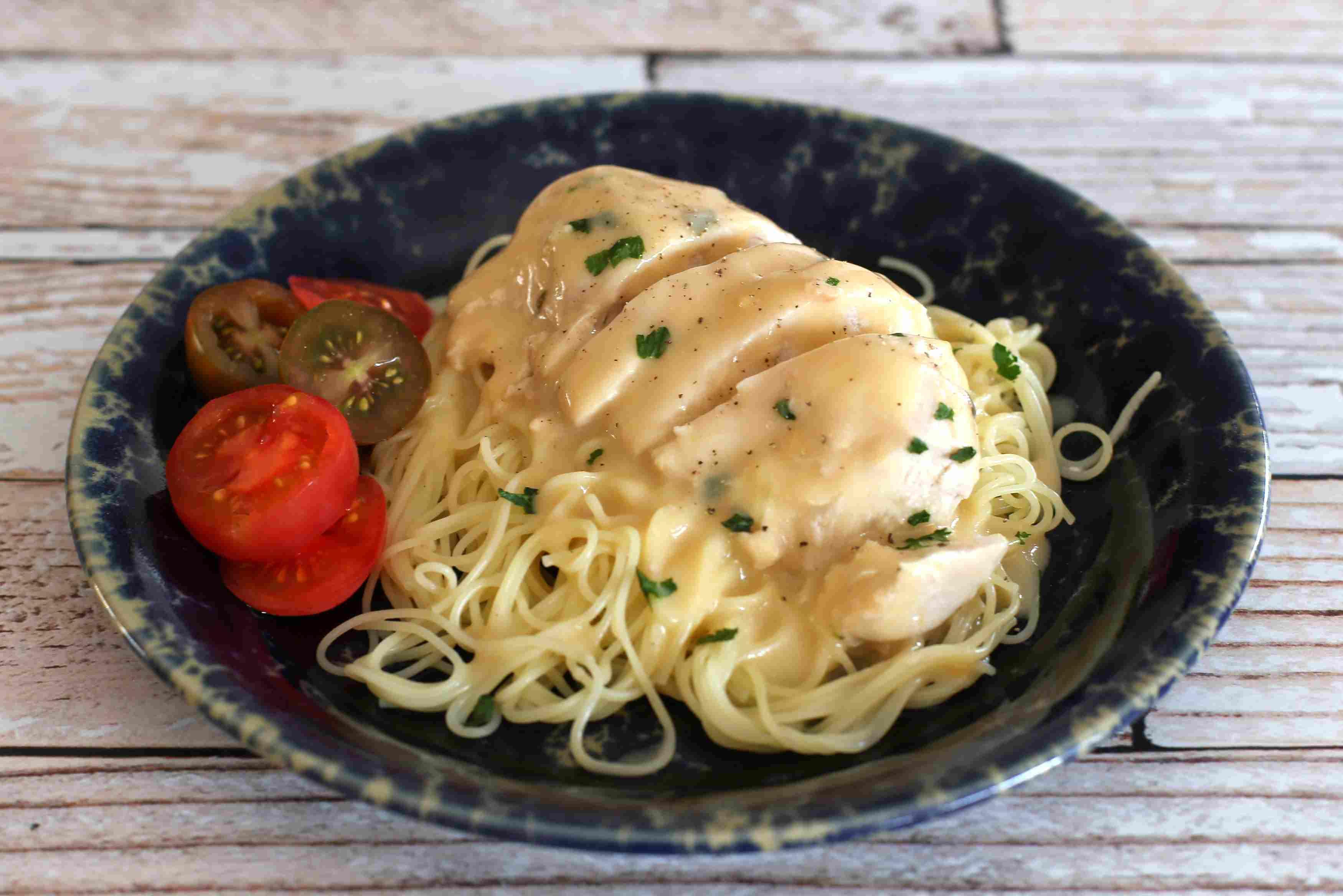 Crock Pot Cheesy Chicken over spaghetti noodes