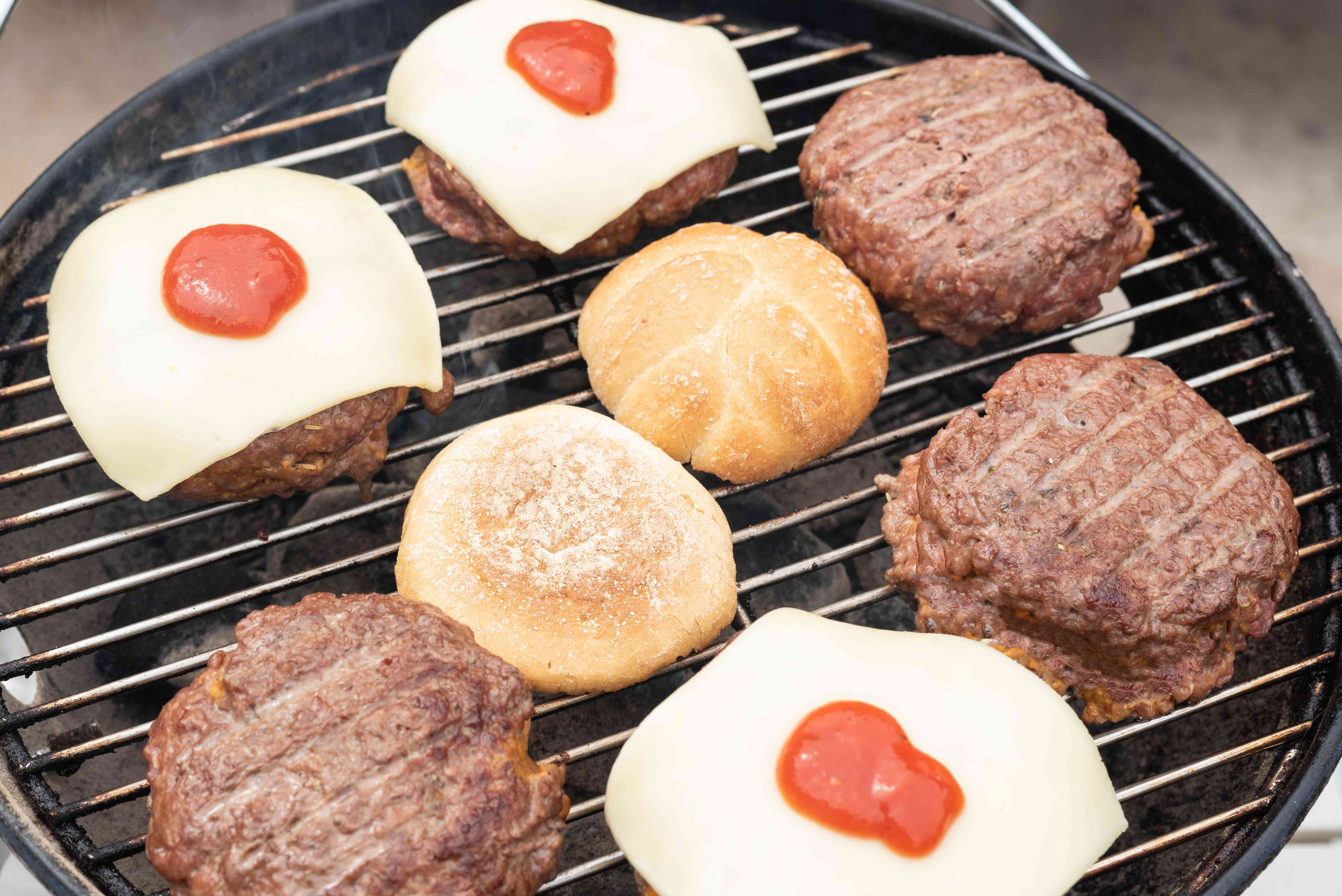 Stuffed pizza burgers on the grill with cheese