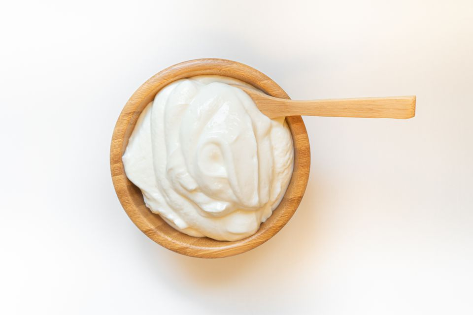 sour cream in a wooden bowl