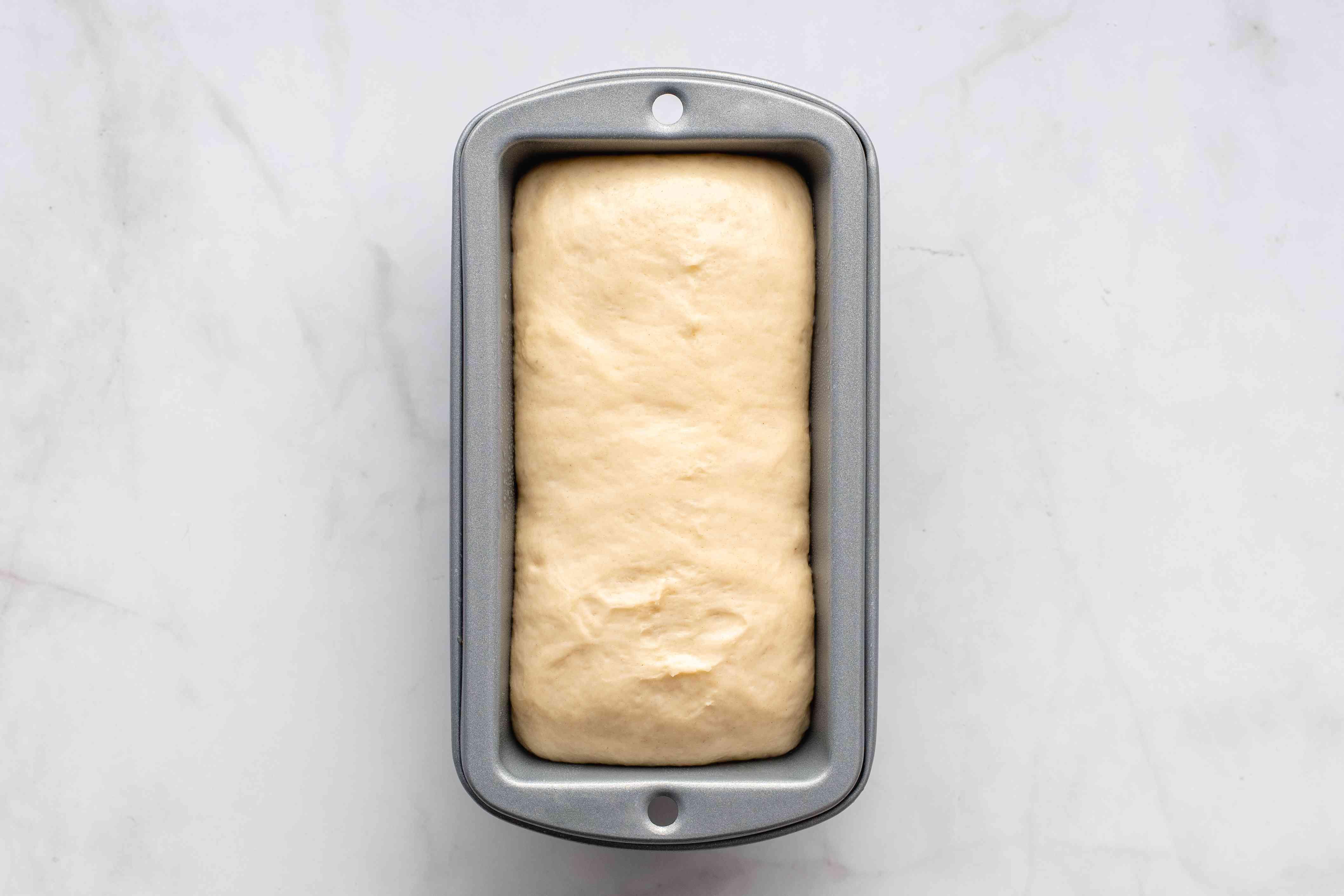 dough in a mini loaf tin