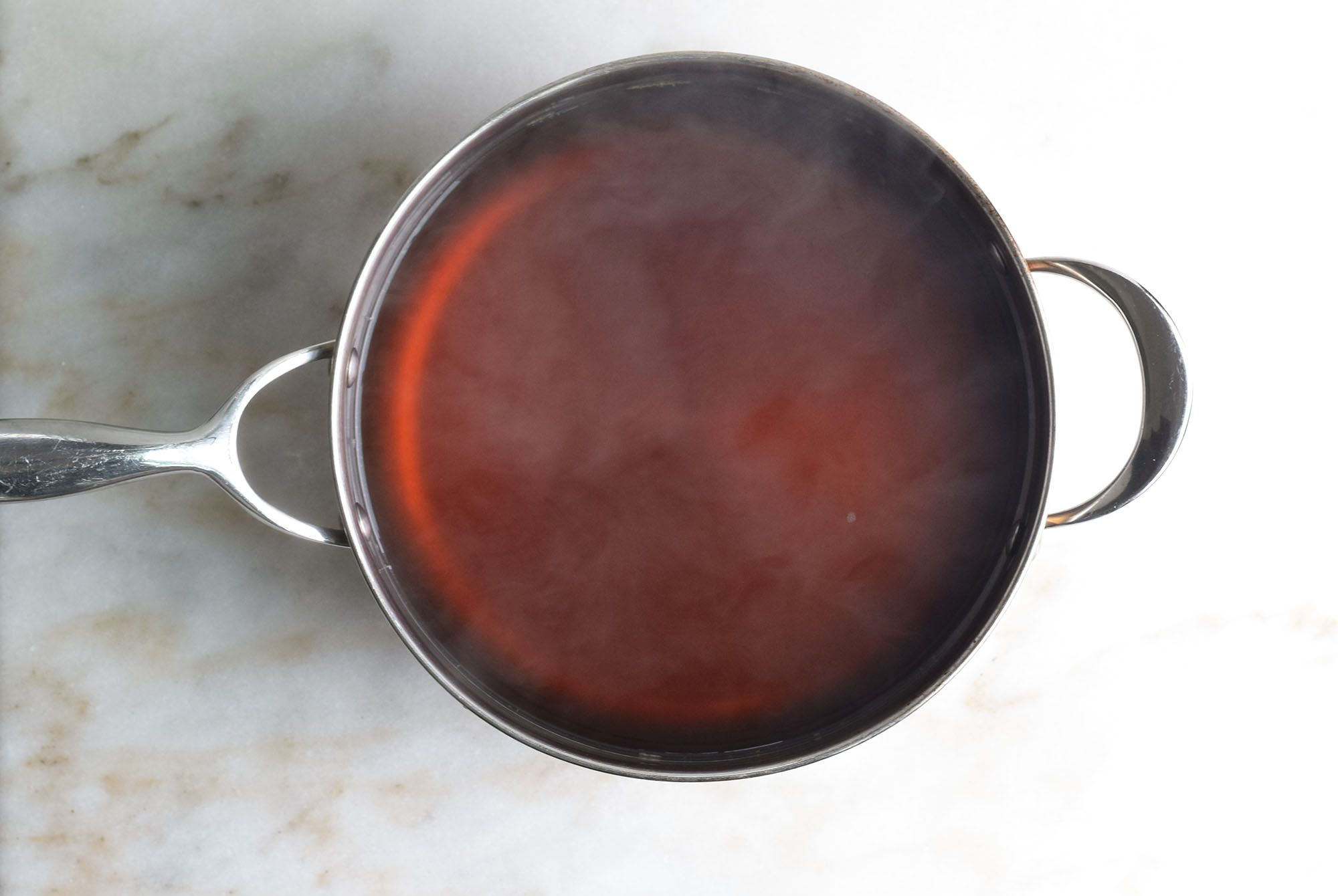 add nstant espresso and remaining sugar into boiling water and mix