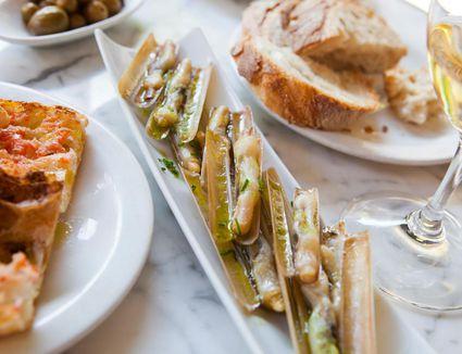 Baby razor clams, tomato rubbed on bread, bread; olives; white wine