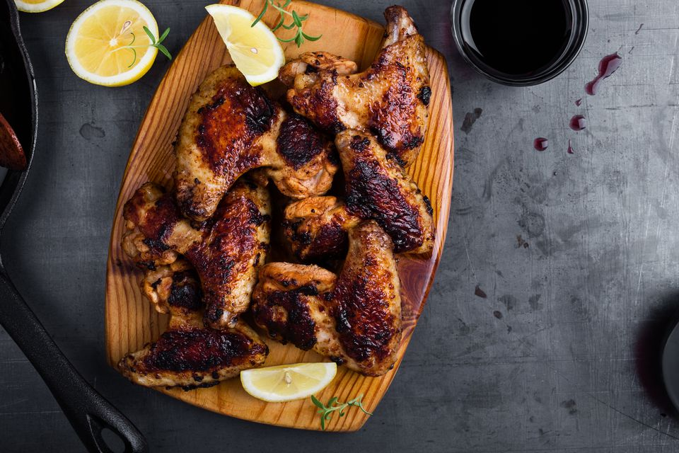 Roast chicken wings on cutting board