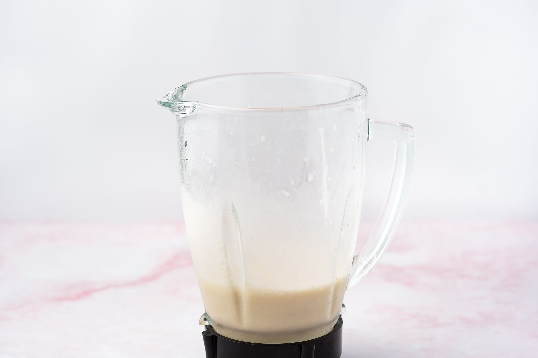 Blending bananas and coconut cream in a blender