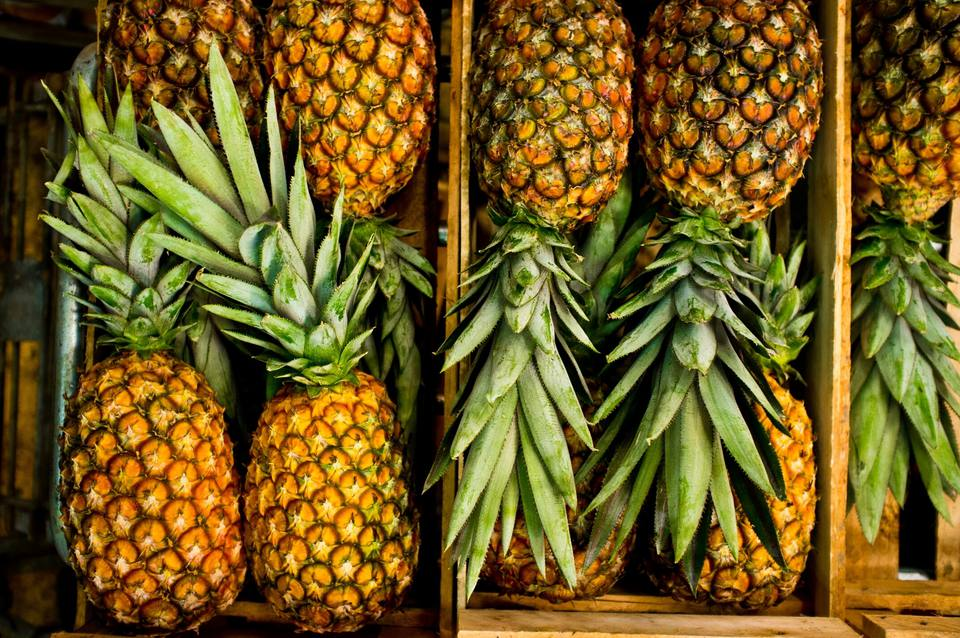 High Angle View Of Pineapples In Crate