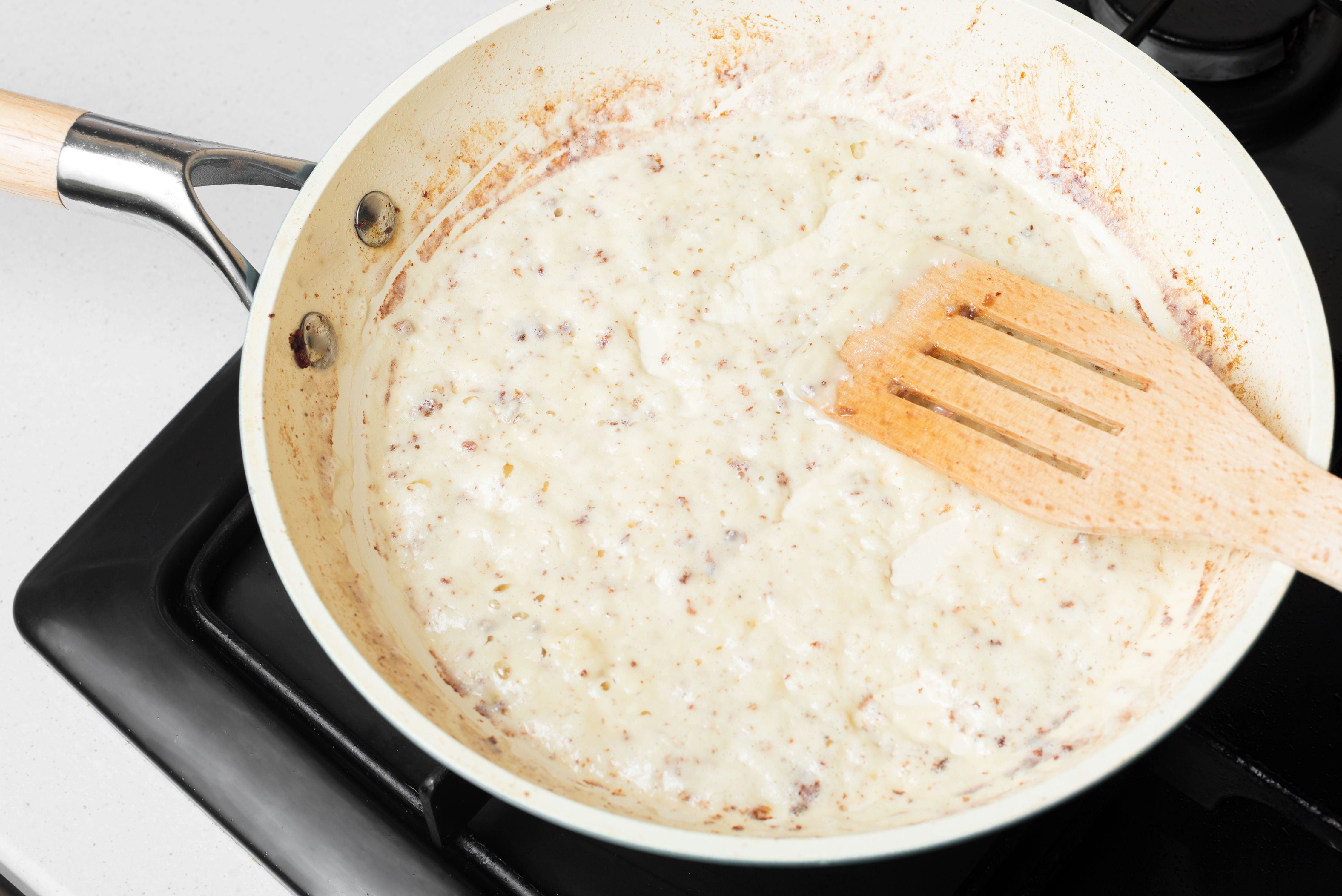 Add oil and flour to drippings in skillet