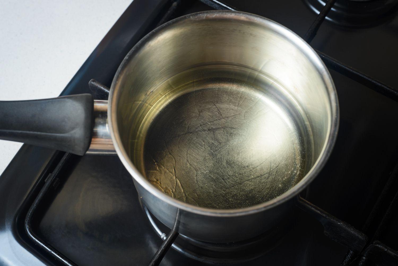Heat oil in saucepan