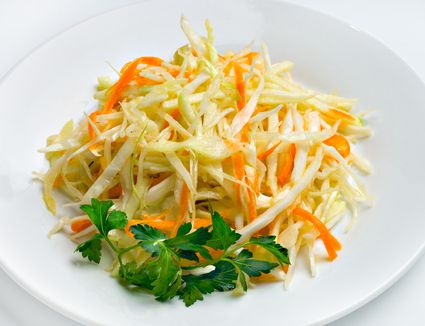 A raw salad of cabbage and carrots with lots of raw goddess dressing