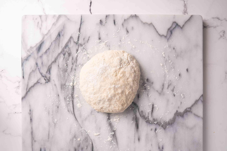 Flour tortilla dough on a marble slab