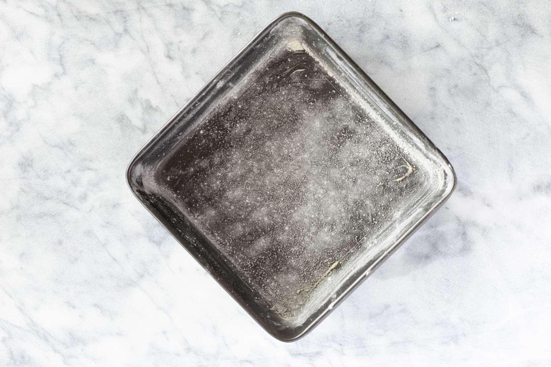 Grease baking pan for carrot cake