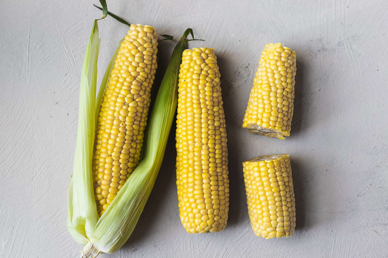 Three ears of husked corn