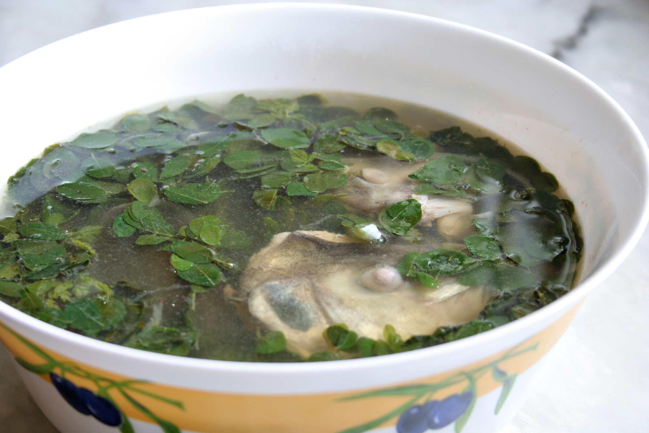 Fish head soup with Moringa leaves
