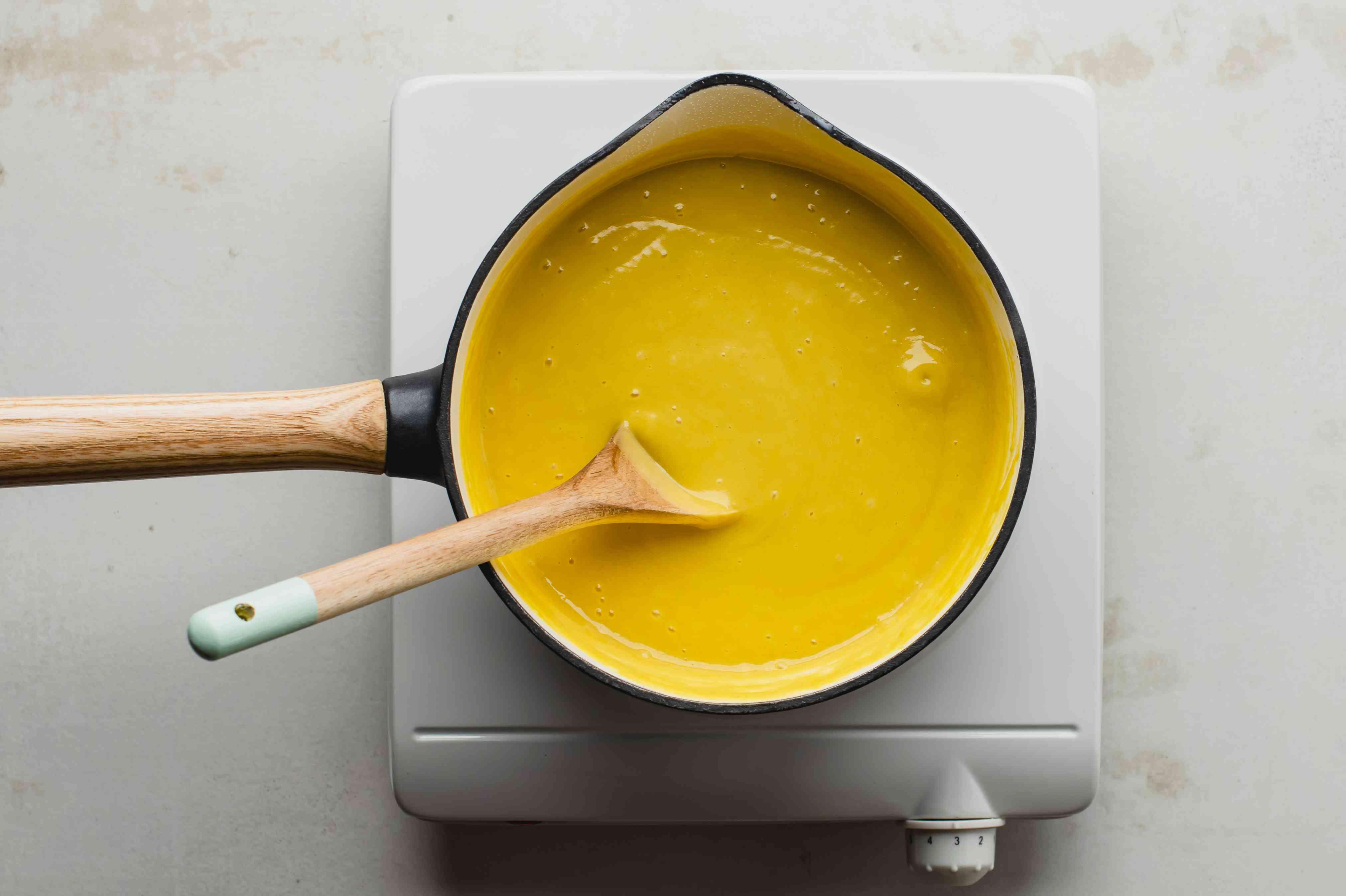 Pour custard into pot