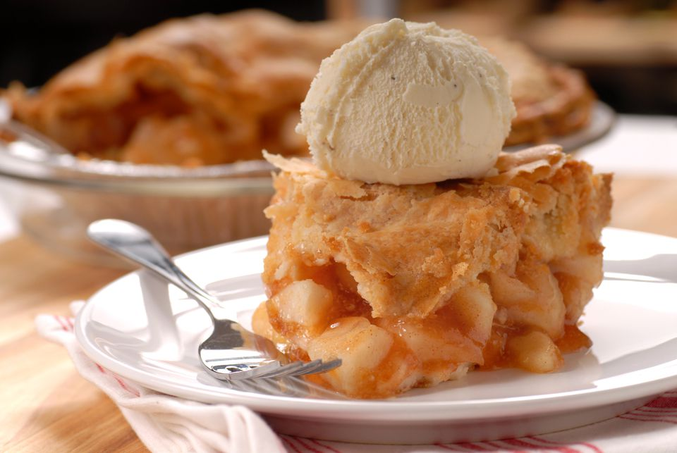 Piece of apple pie with vanilla ice cream
