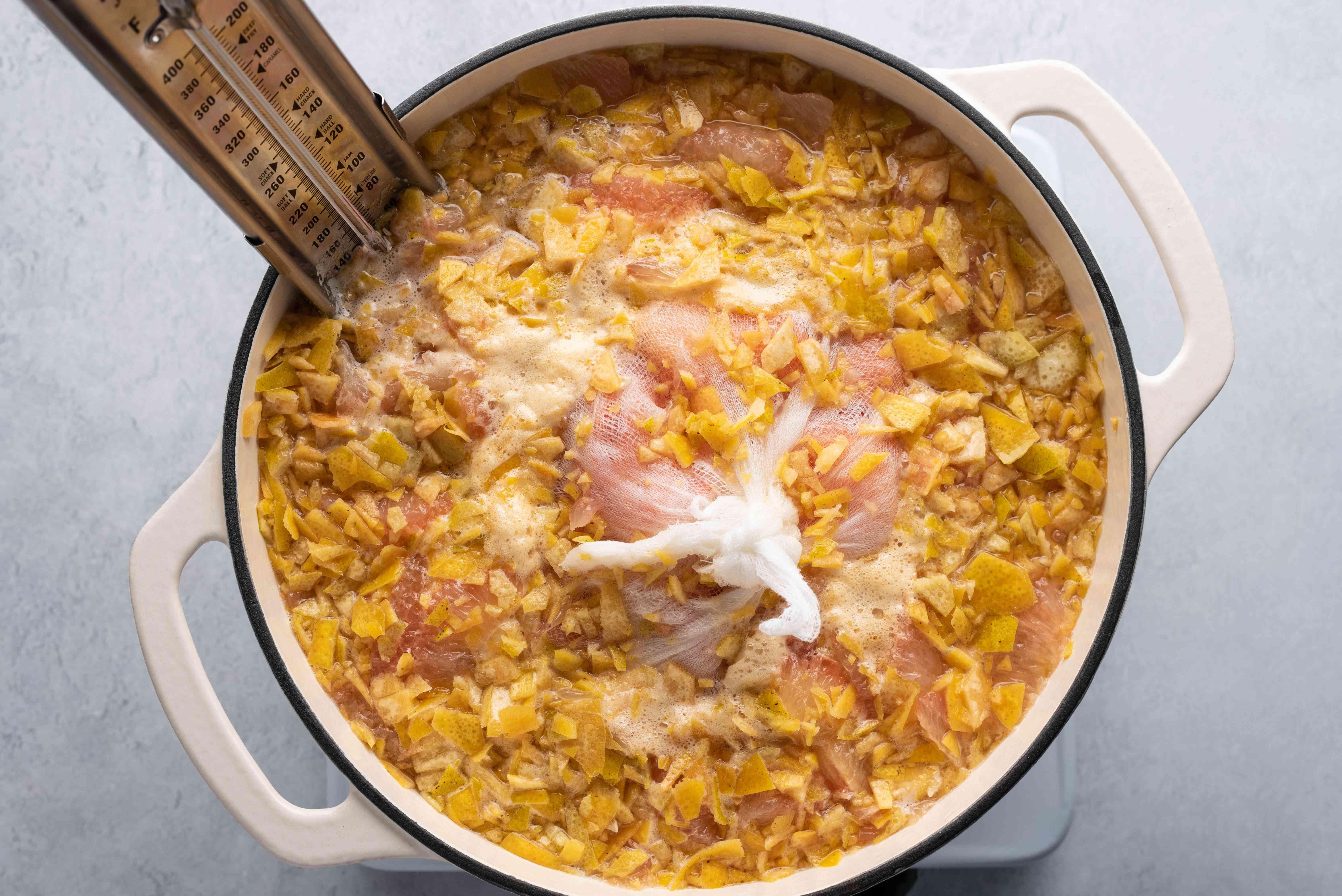 grapefruit marmalade mixture cooking in a pot