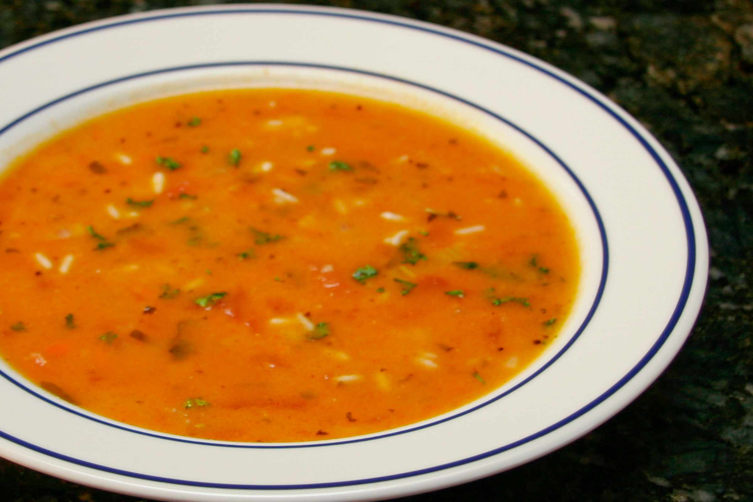 tomato rice soup in a wide bowl
