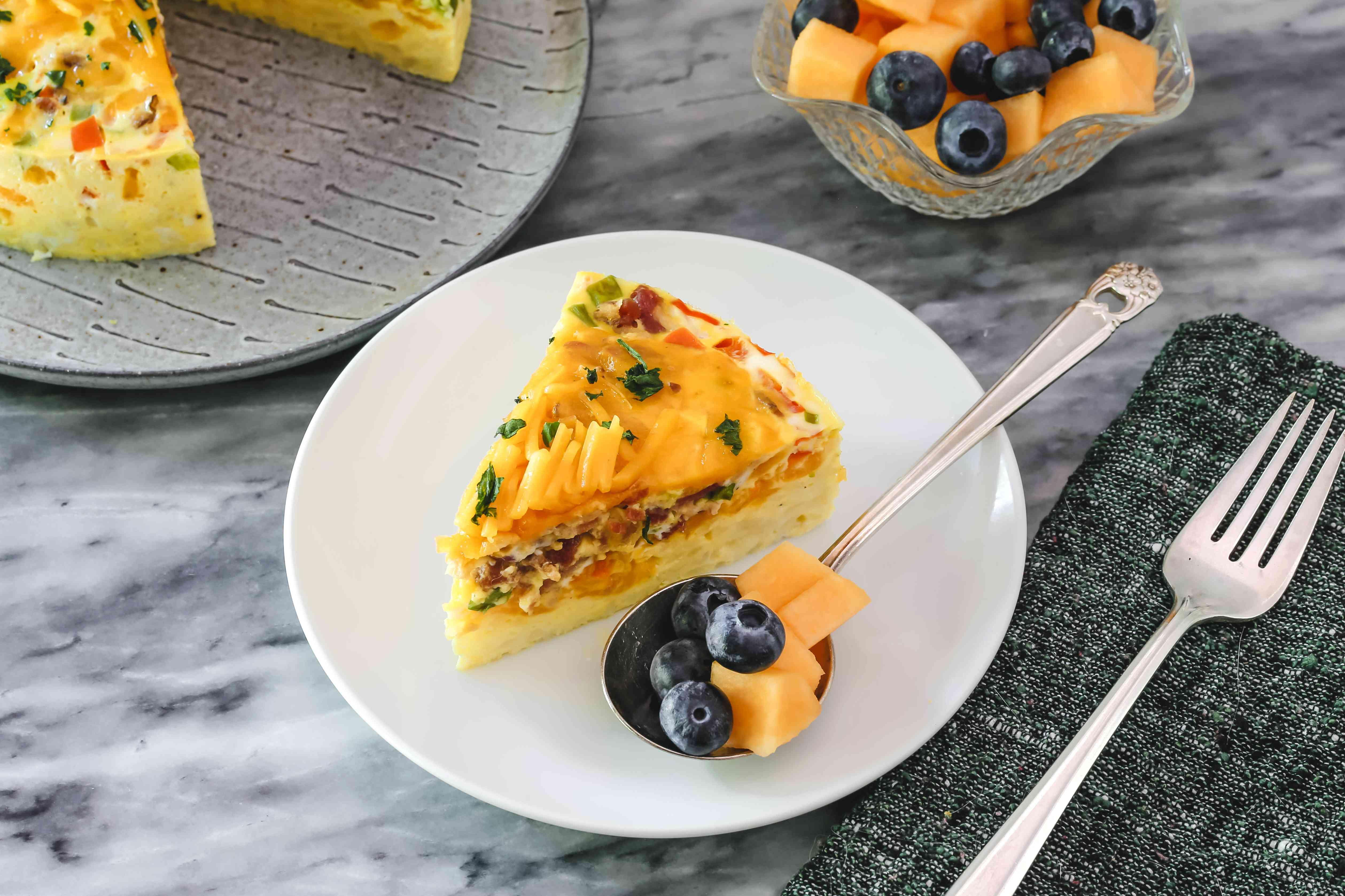 slice of breakfast casserole with fruit