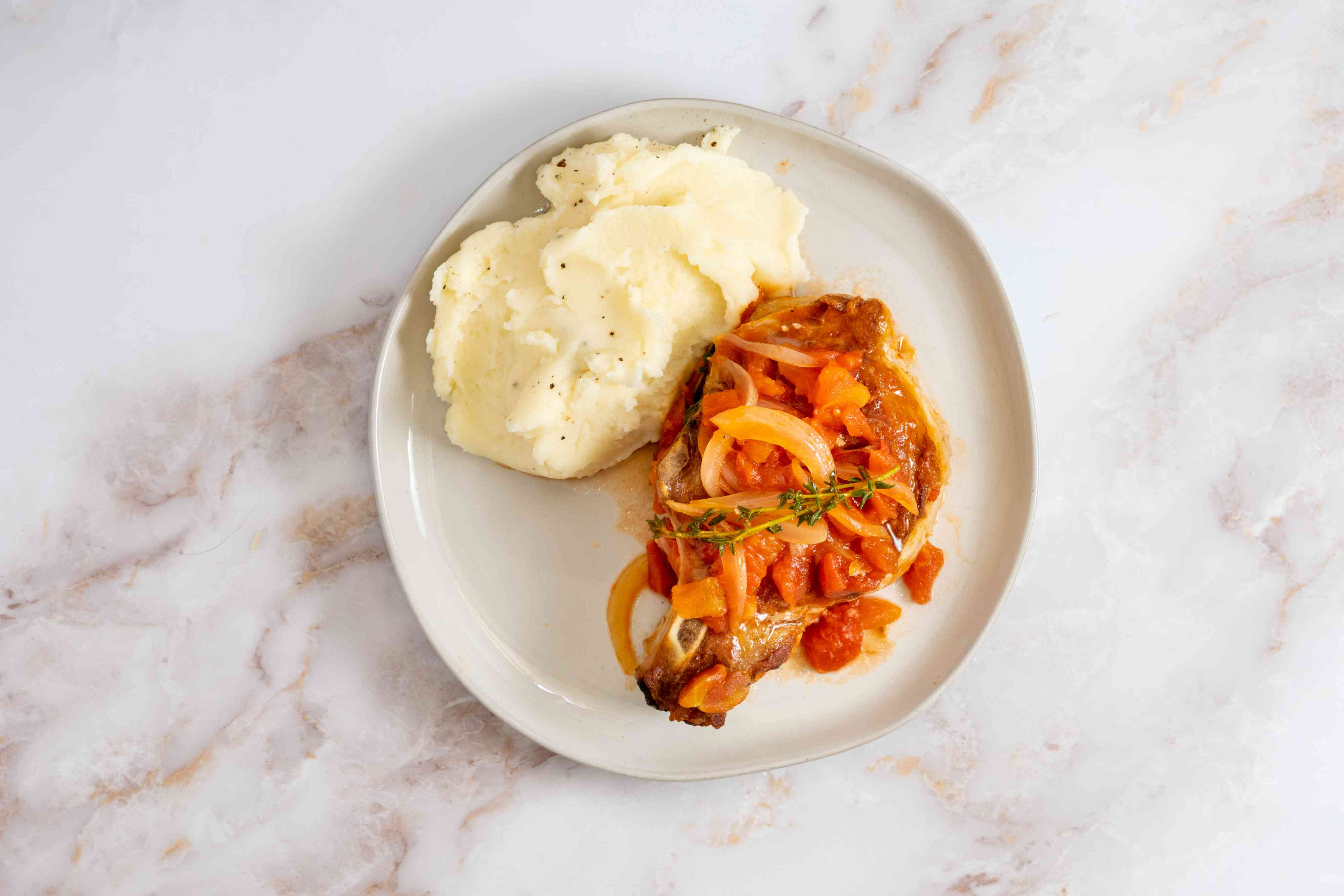 Pork Chops With Tomatoes and Garlic served with mashed potatoes