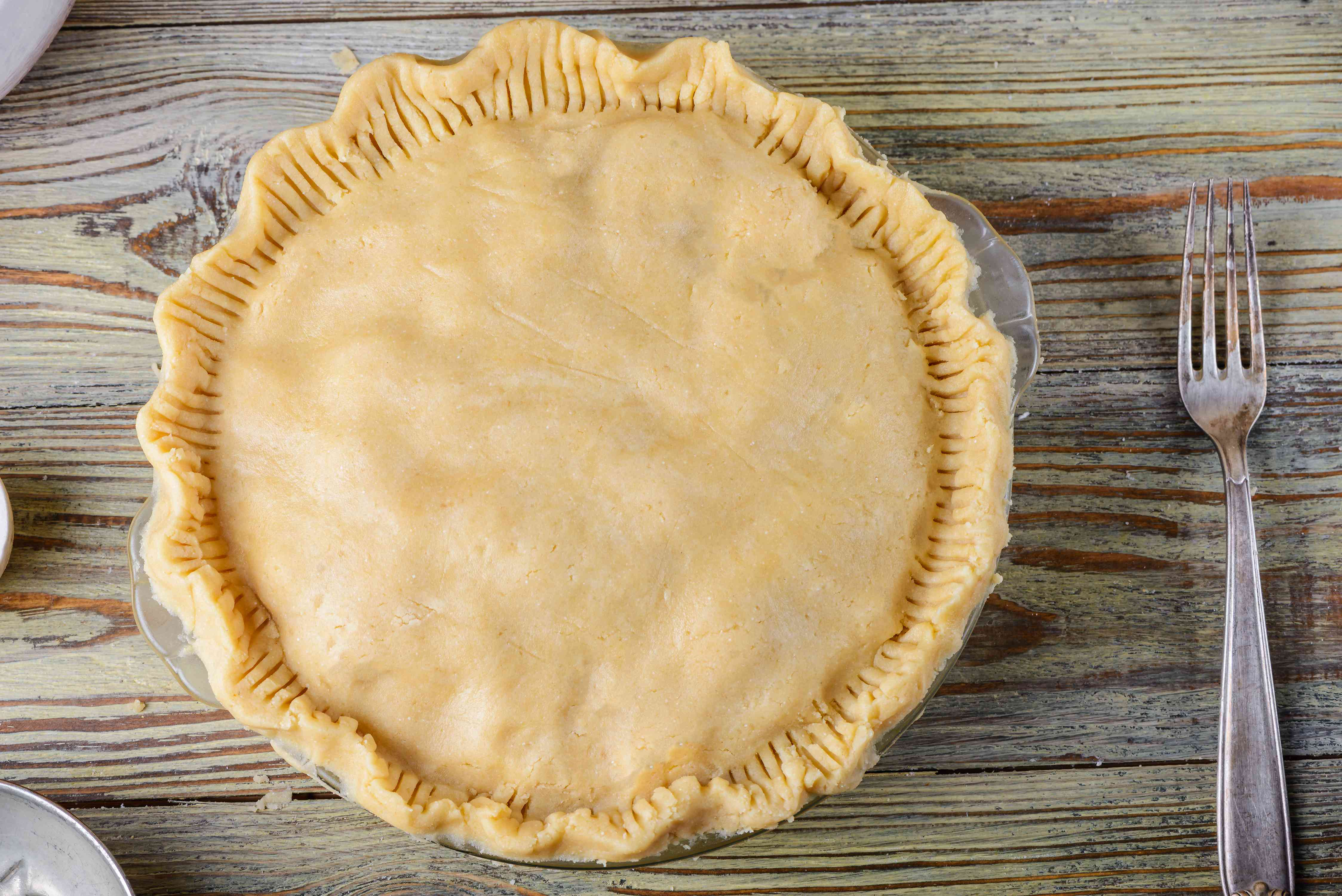 Put dough over pie