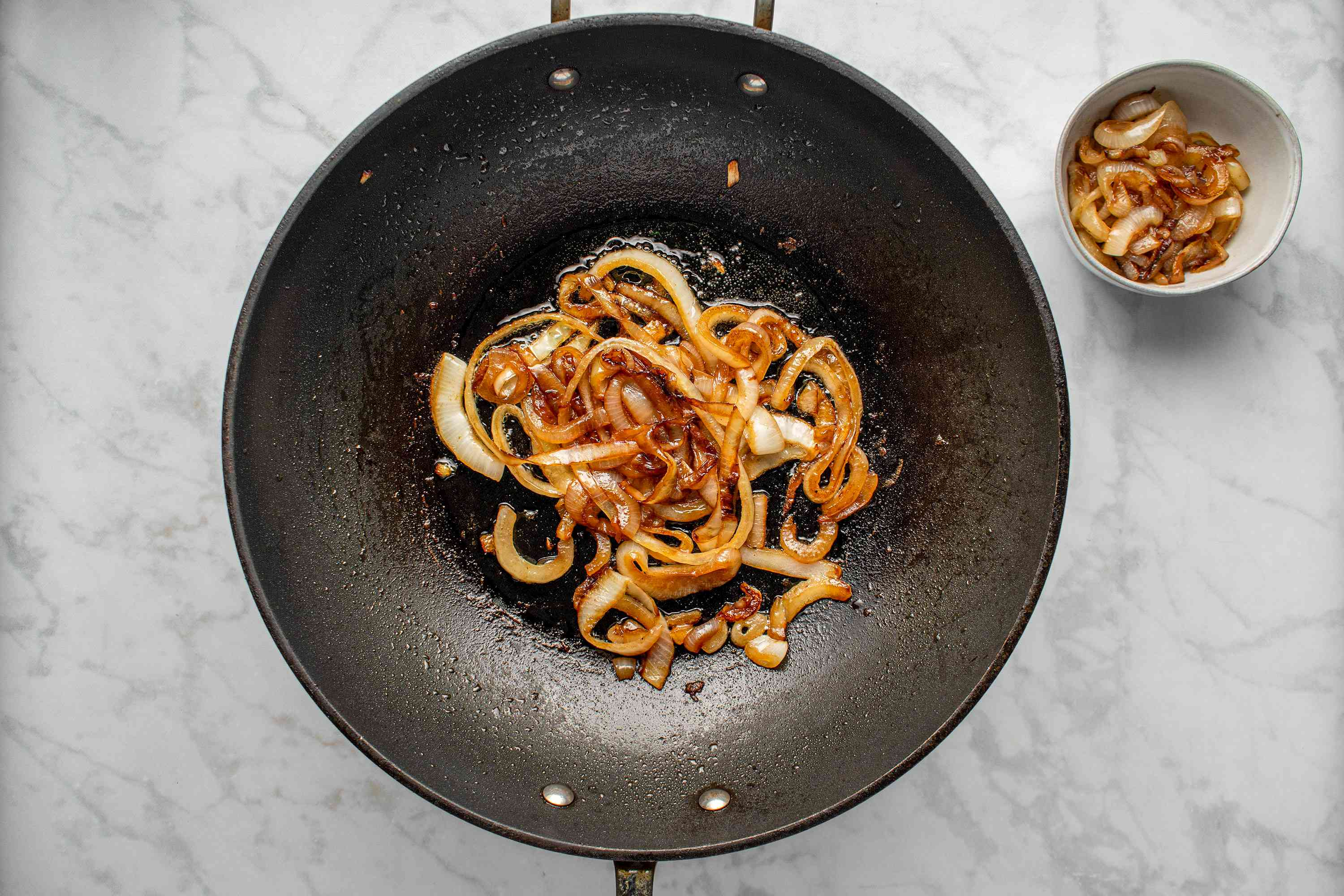 onions in a wok, onions in a bowl
