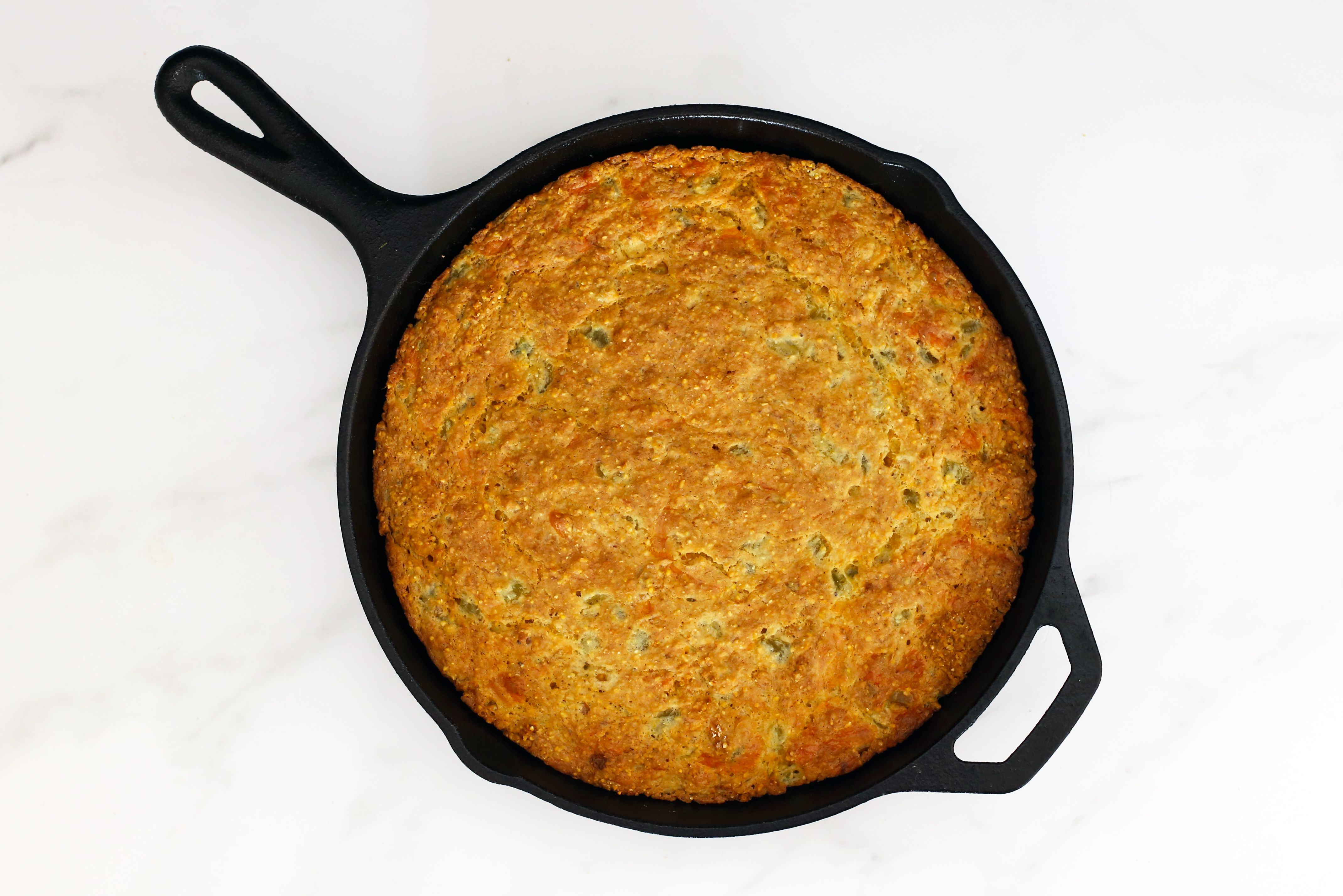 Baked Mexican cornbread in the skillet.