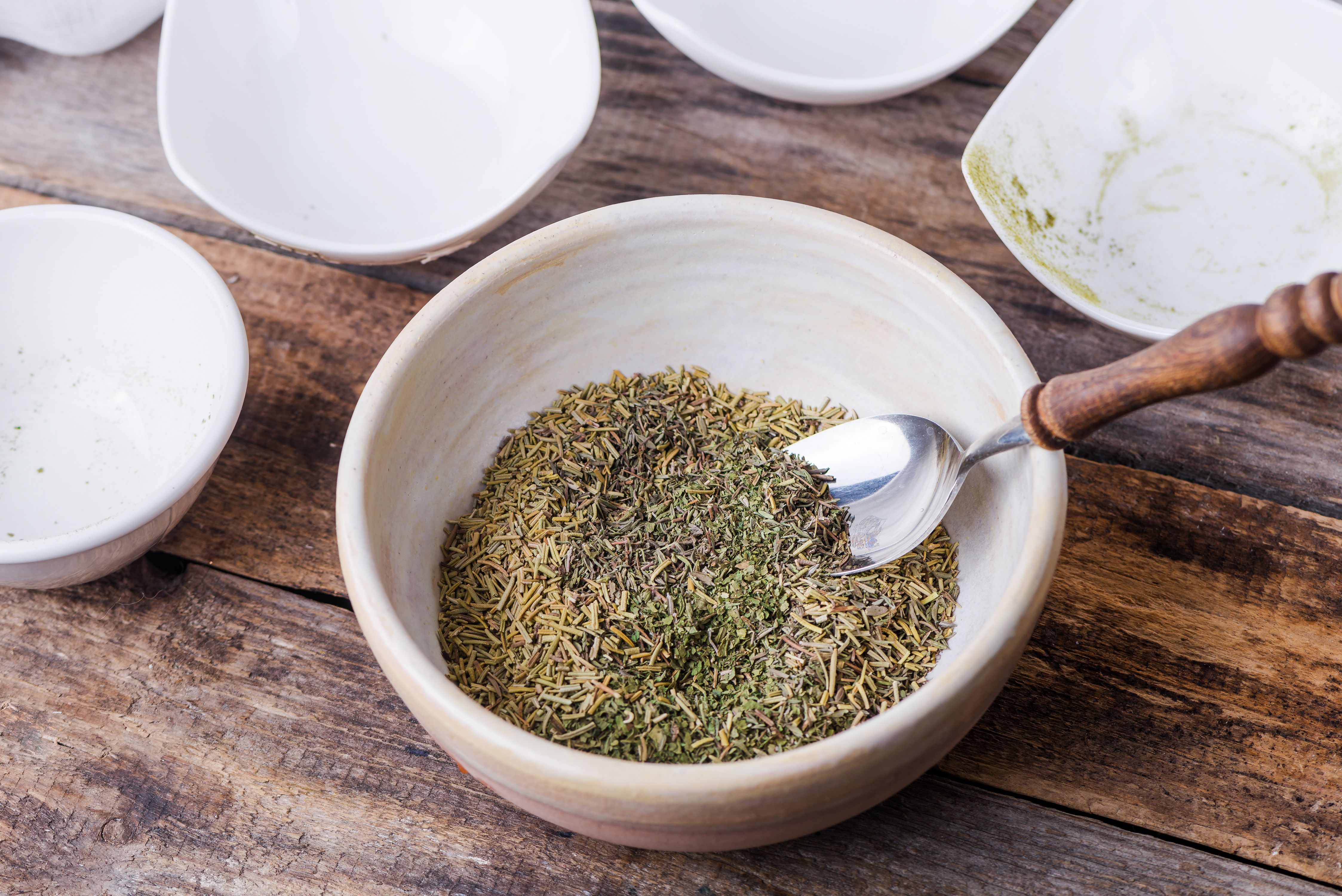 Spices combined in a bowl with a spoon