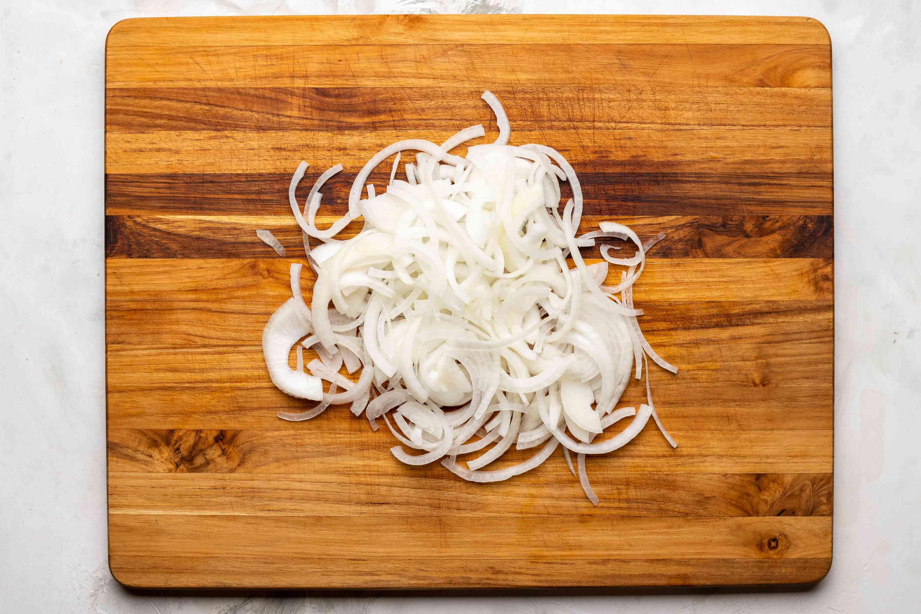 Peel and thinly slice the onion on a cutting board